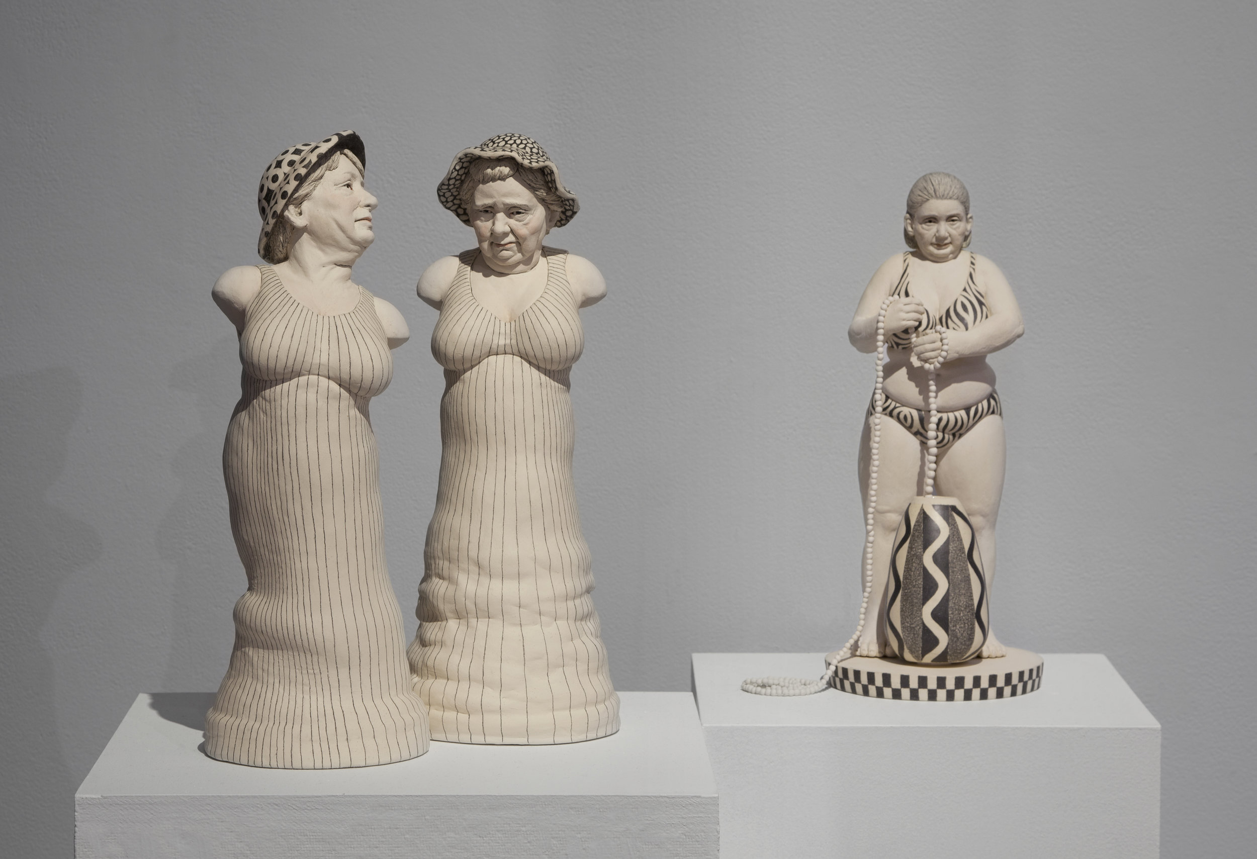 """A Confidence between Friends (left)  stoneware, graphite pencil  2 figures, 16"""" high  $1,800"""