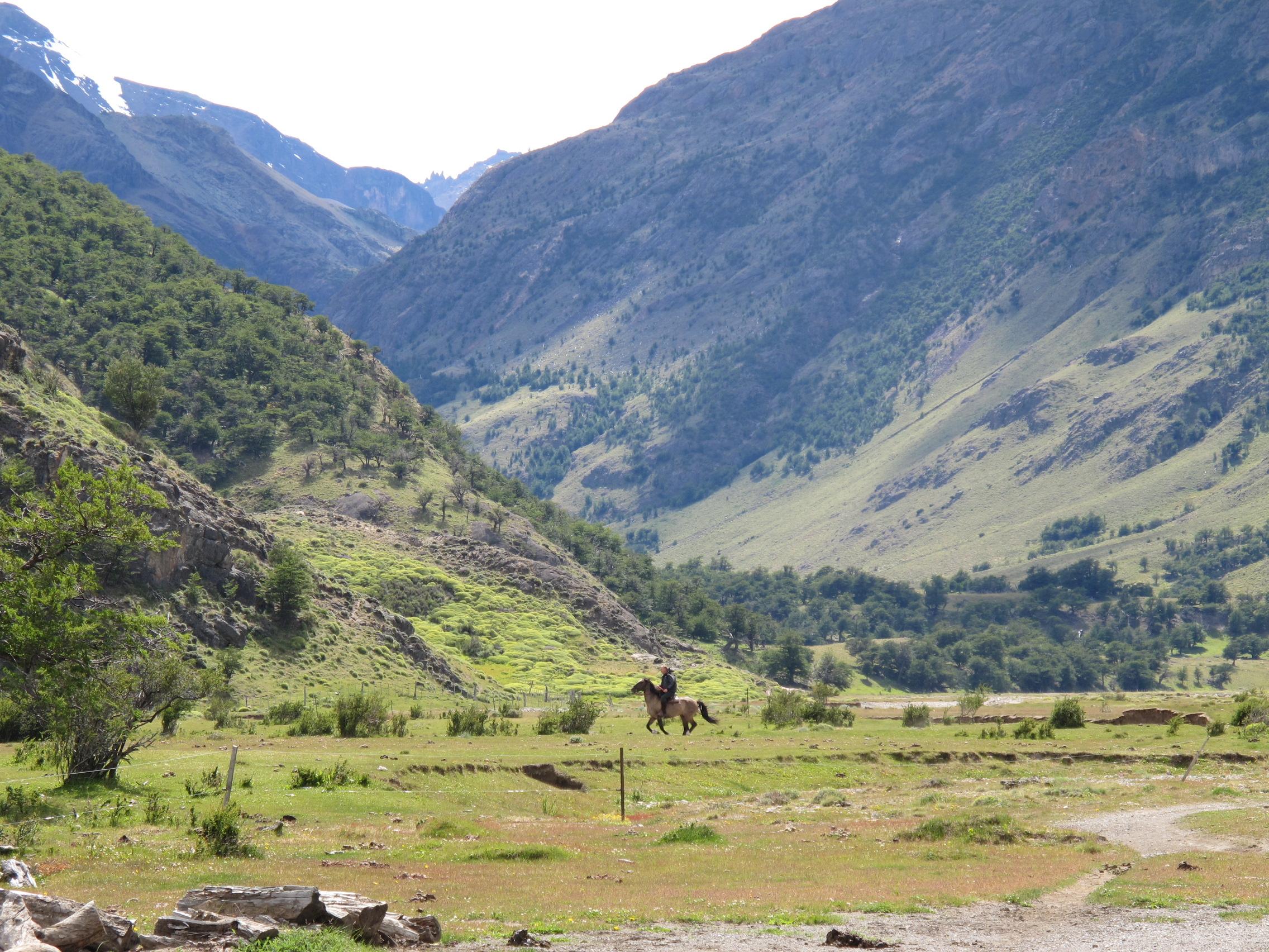 Greg riding below the hills