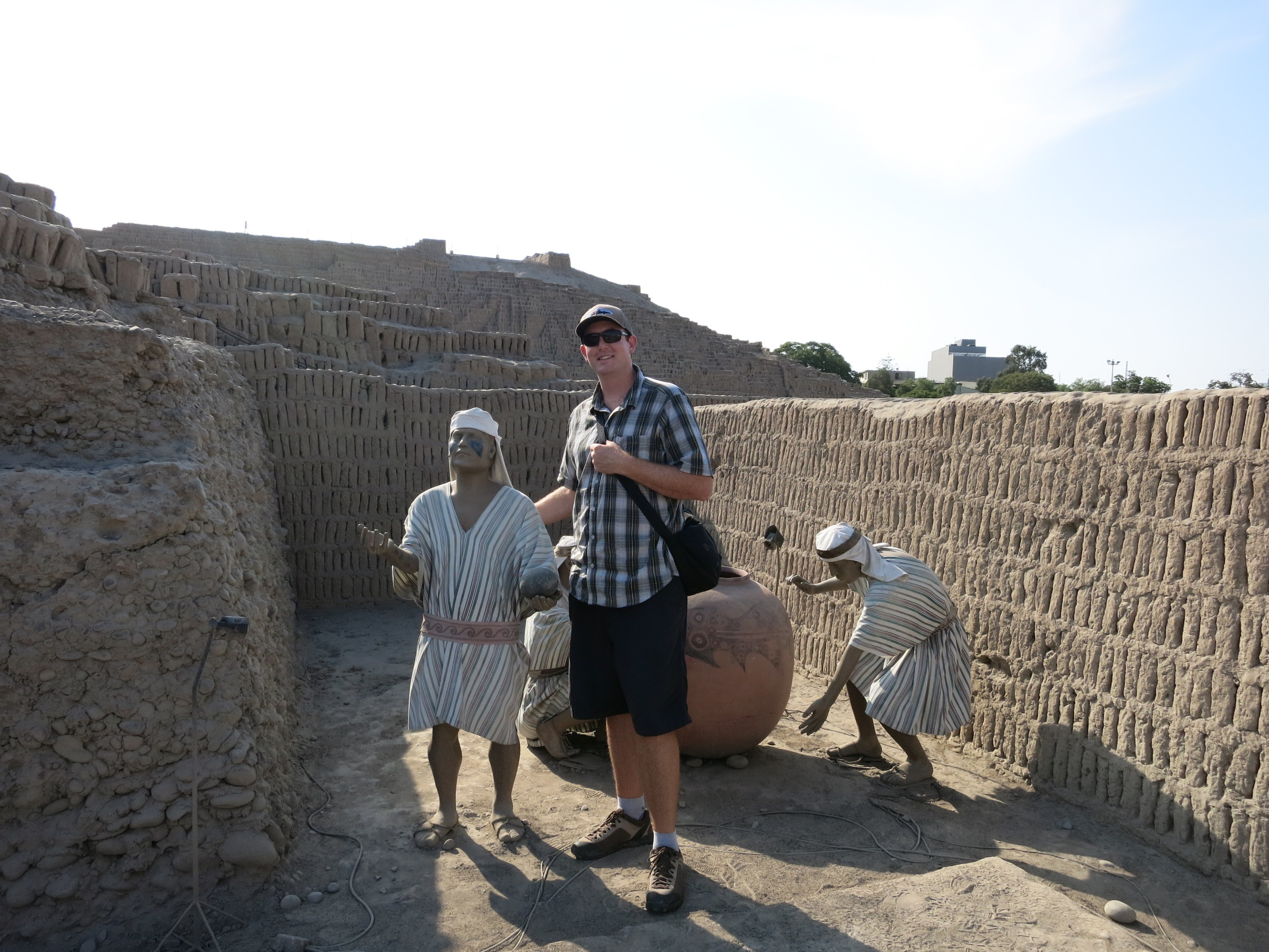 At Huaca Pucllana, Eric demonstrates how little the people were!