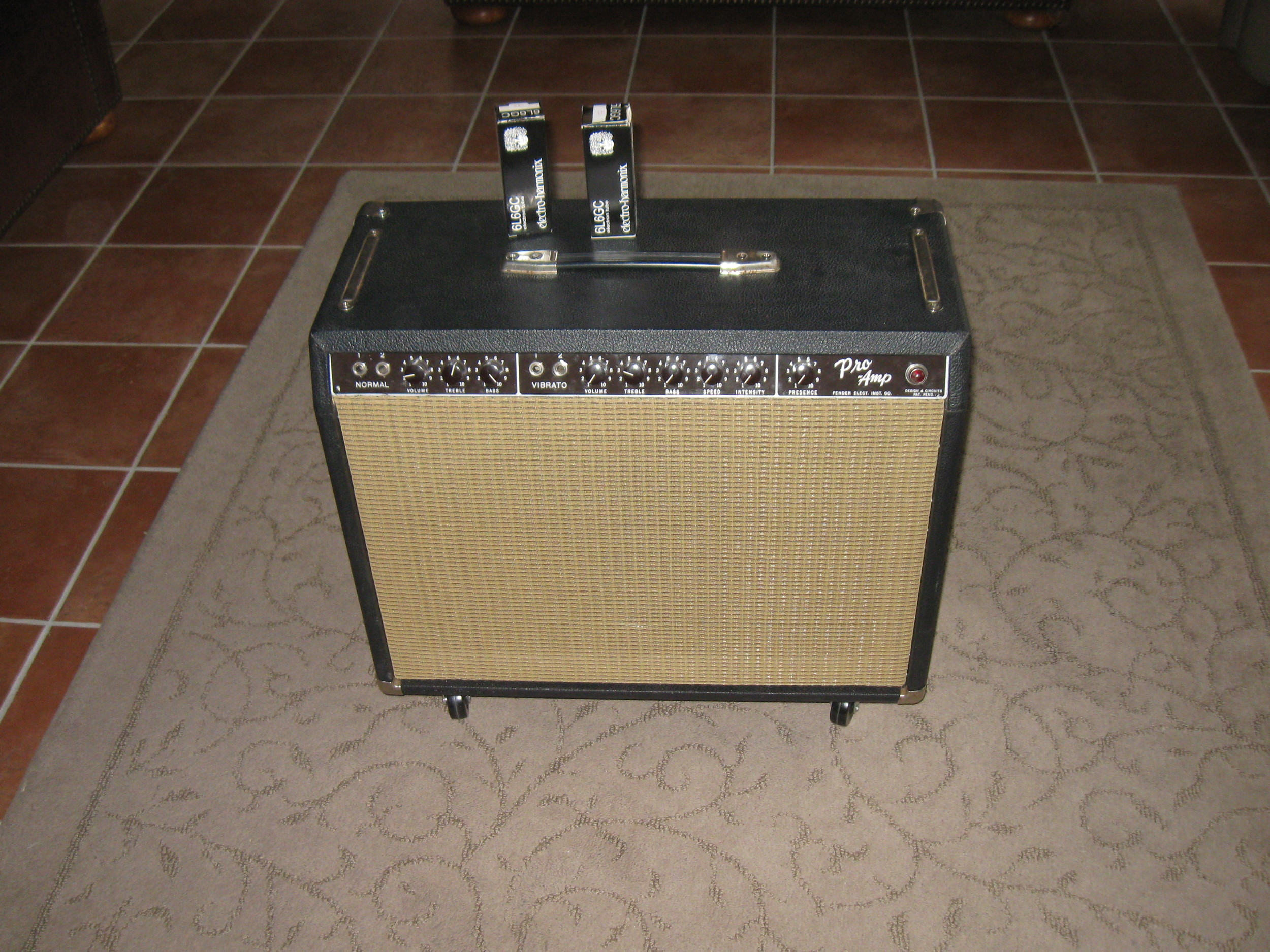 Fender Brownface Pro. It came in as just a chassis and a non-original cab. Once a few components were switched out, it was re-tubed, the grill cloth was replaced, casters were added and a Weber 50 Watt Alnico Speaker was put in. Man this thing was cool!