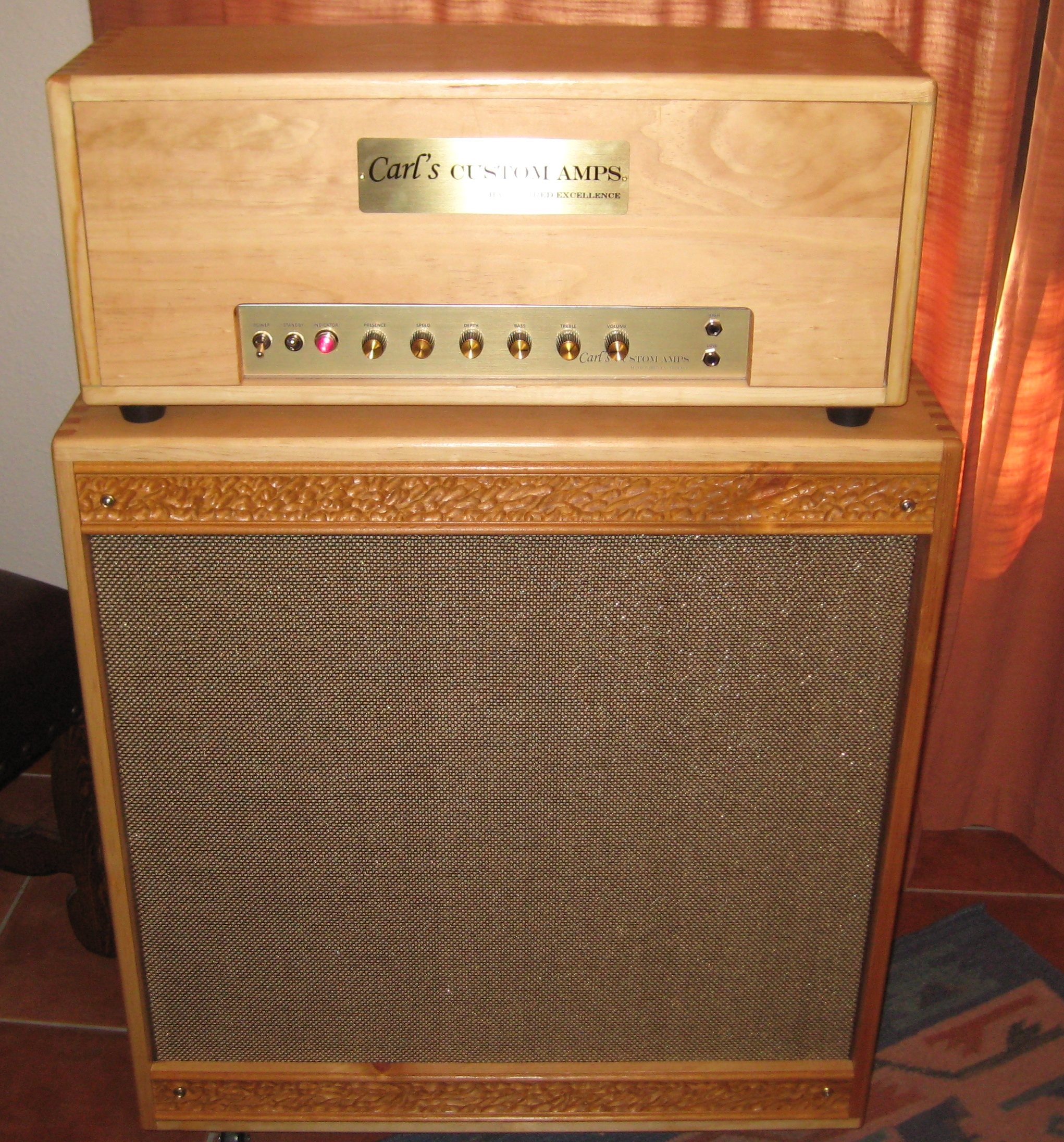 Custom made head with 20 Watt Blonde Bassman Circuit with bias shifting Tremolo. I made the cabs too!