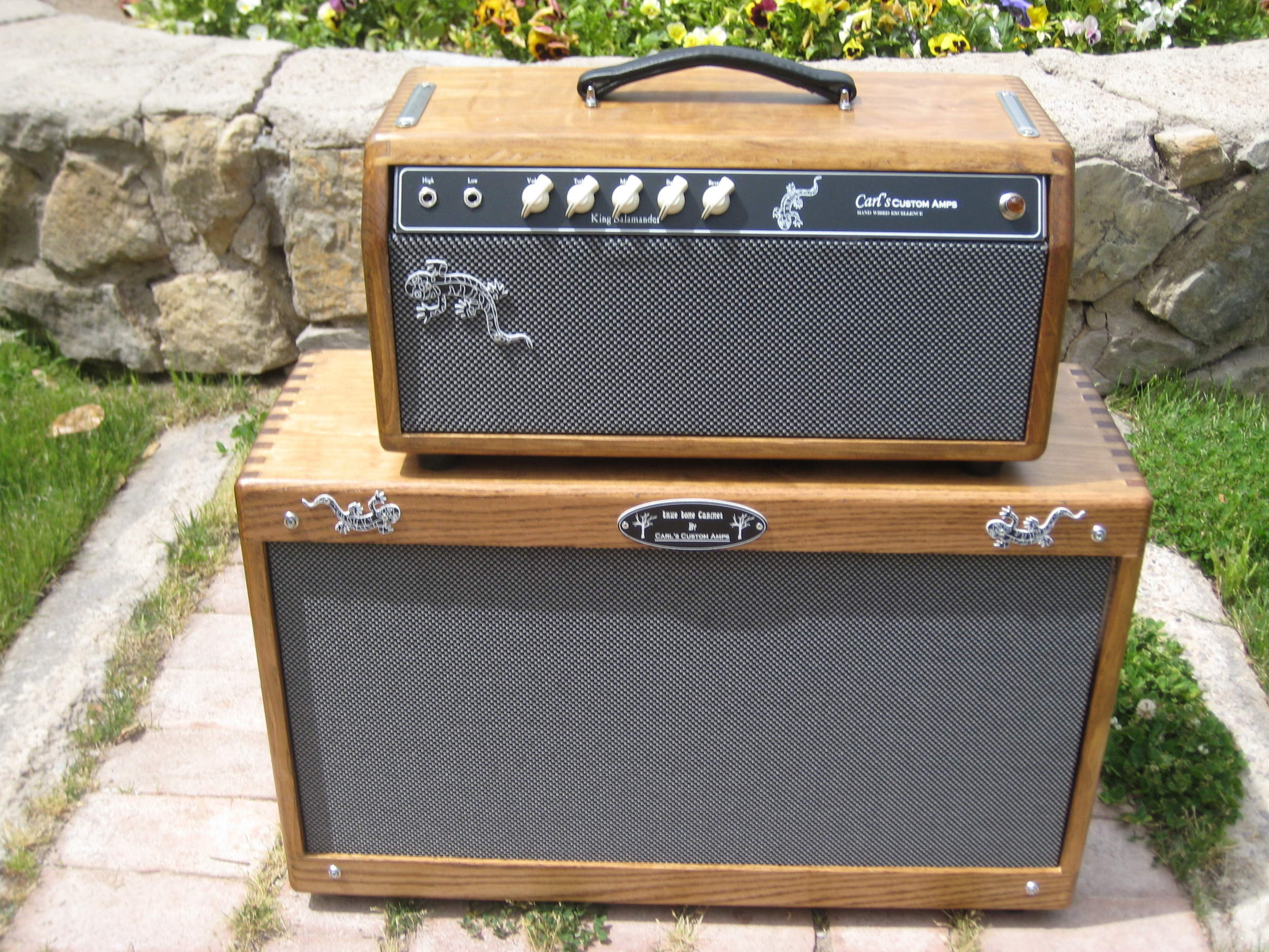 This custom amp was built for the band King Salamander. Unique improved Fender Blackface circuit with reverb. The cab has a pair of Weber Speakers