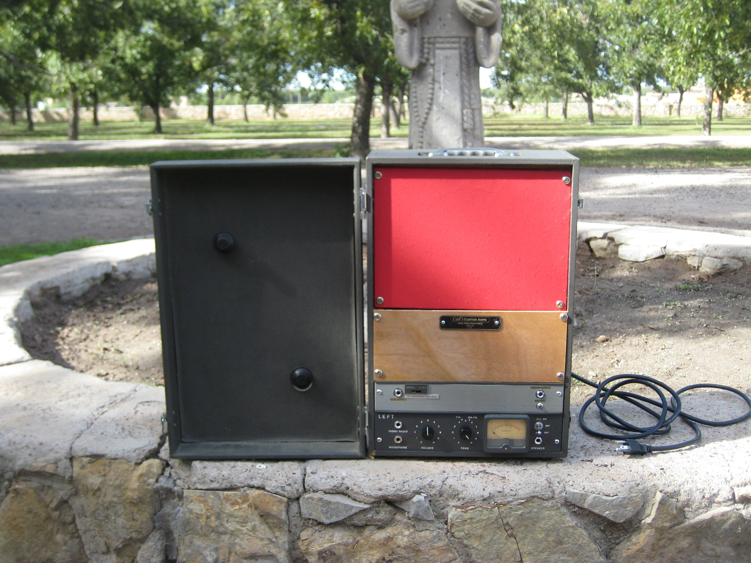 I did this one a while back . This little amp was built out of and old Reel to Reel tape recorder. The Tape player did so I converted the amp over to a 5 Watt Tweed Princeton with an El-84 and added an 8 inch speaker. The Meter lights up and moves.