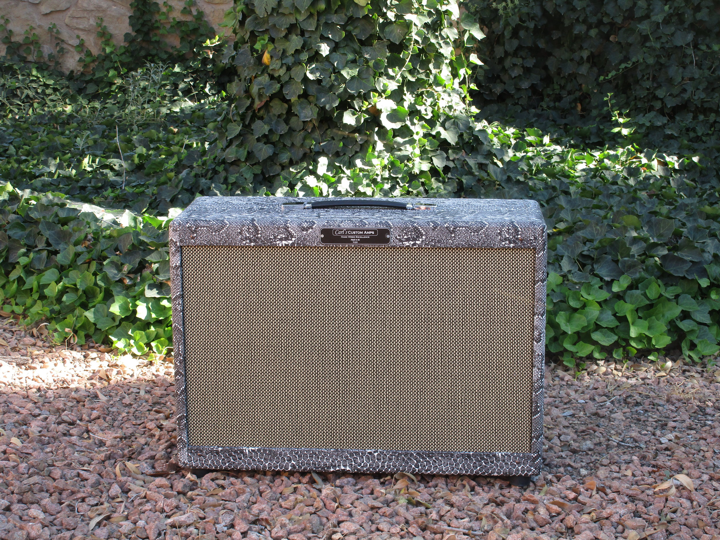 Neatcustom 2x12 Cab with Weber Blue Dog and Silver Bell speaker. The cab is pine with floating baffle lots of great character! Cab like this run about $645.