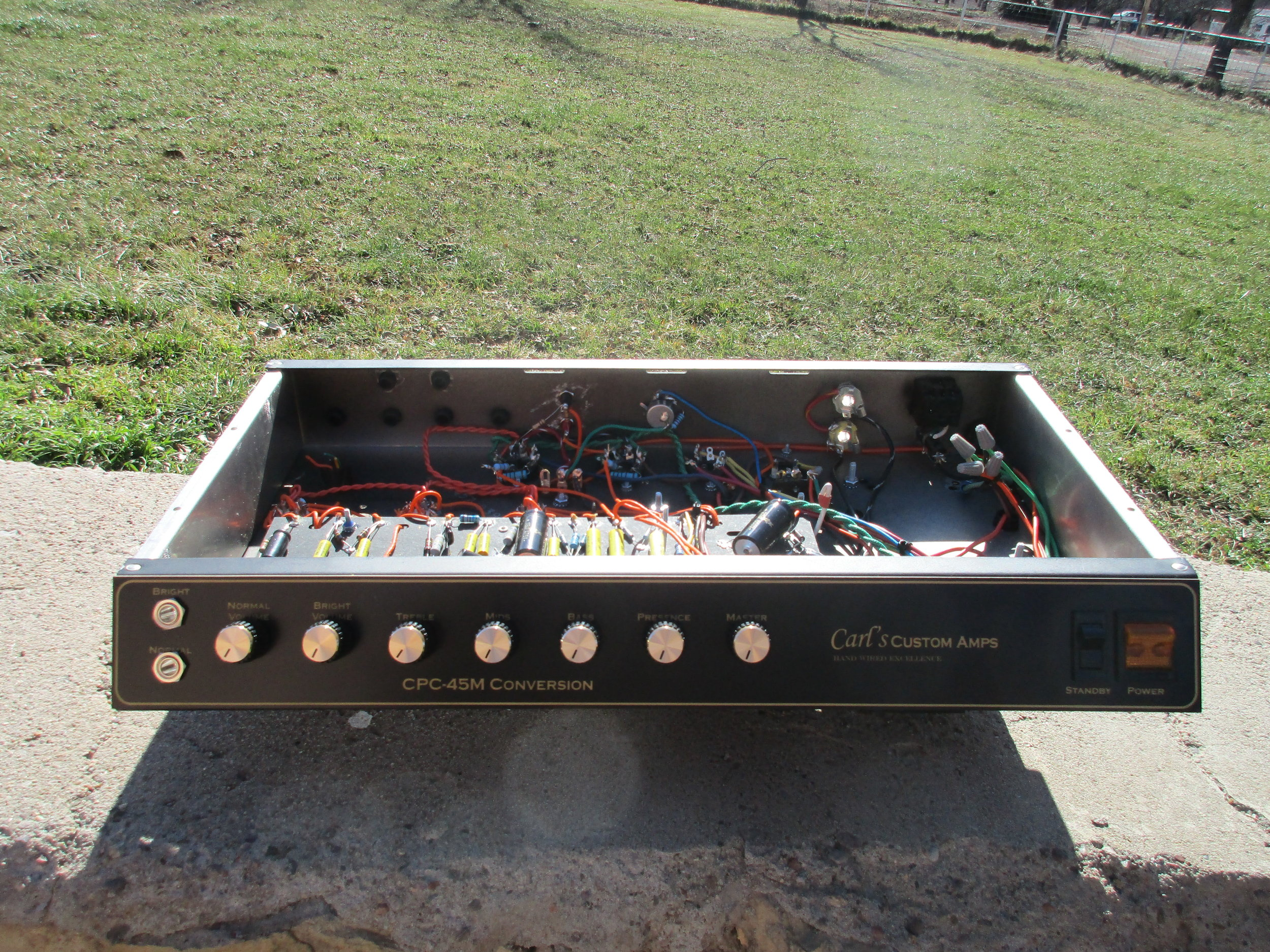 I did this one quite awhile ago. I converted this old Dean Markley in JTM-45 style amp with single input for each channel. Great sounding amp!!