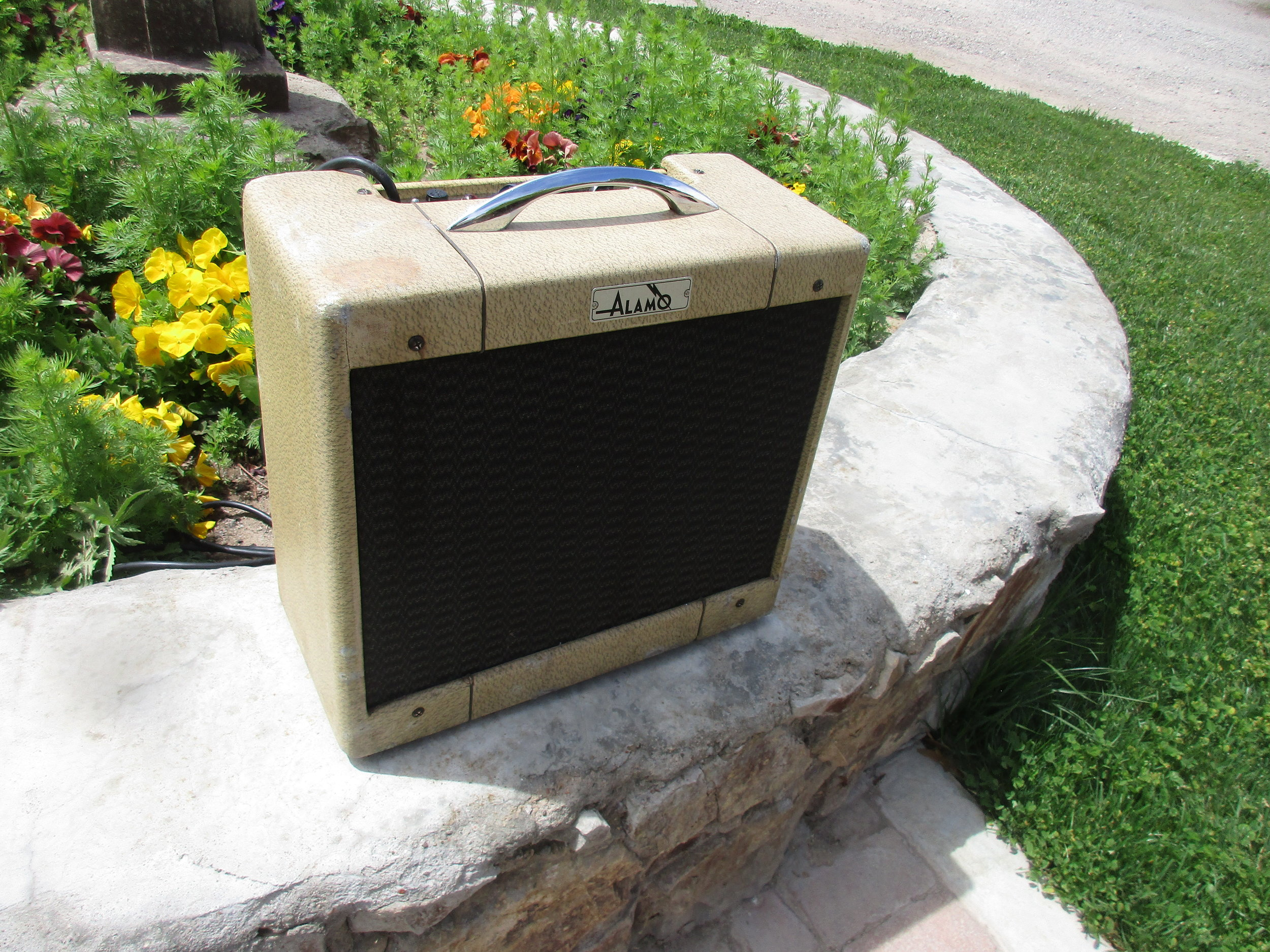 This late 50's Alamo amp came in with lots of problems plus they never really sounded to great to begin with (although they look really cool!). We re-capped the amp, re-coned the speaker, replaced some tubes and modified the amp to sound more like a Tweed Deluxe. It's killer little amp now!