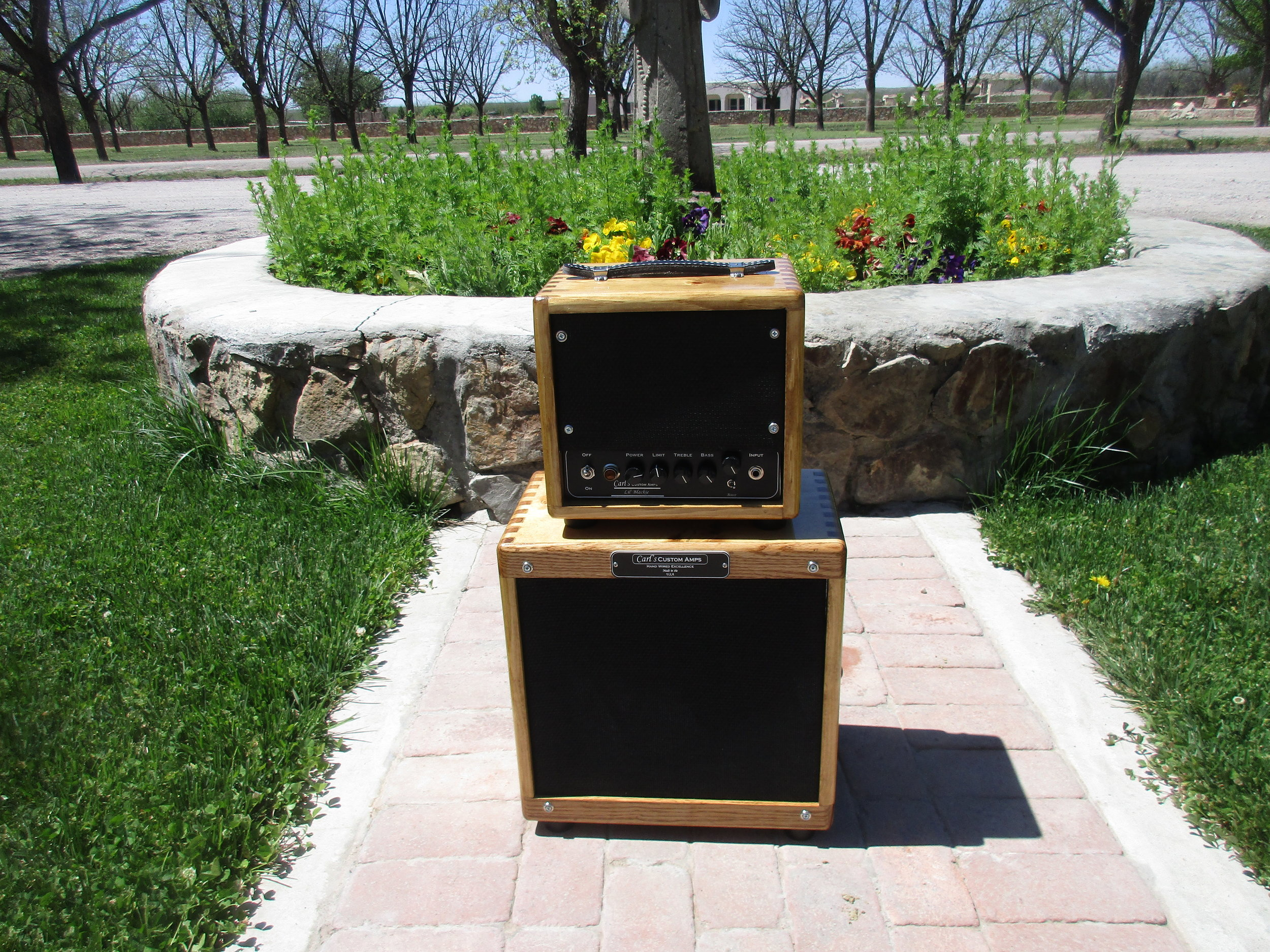 This head and cab is Blackface Champ with number of mod: variable power, tube swapping capable, and eq lift. The cab is loaded with Alinco Weber California. It a small but toneful package. I built the cab myself and they hand finished with a stain and 16 coats of my own wiping varnish. It's a lot of work man they look great!