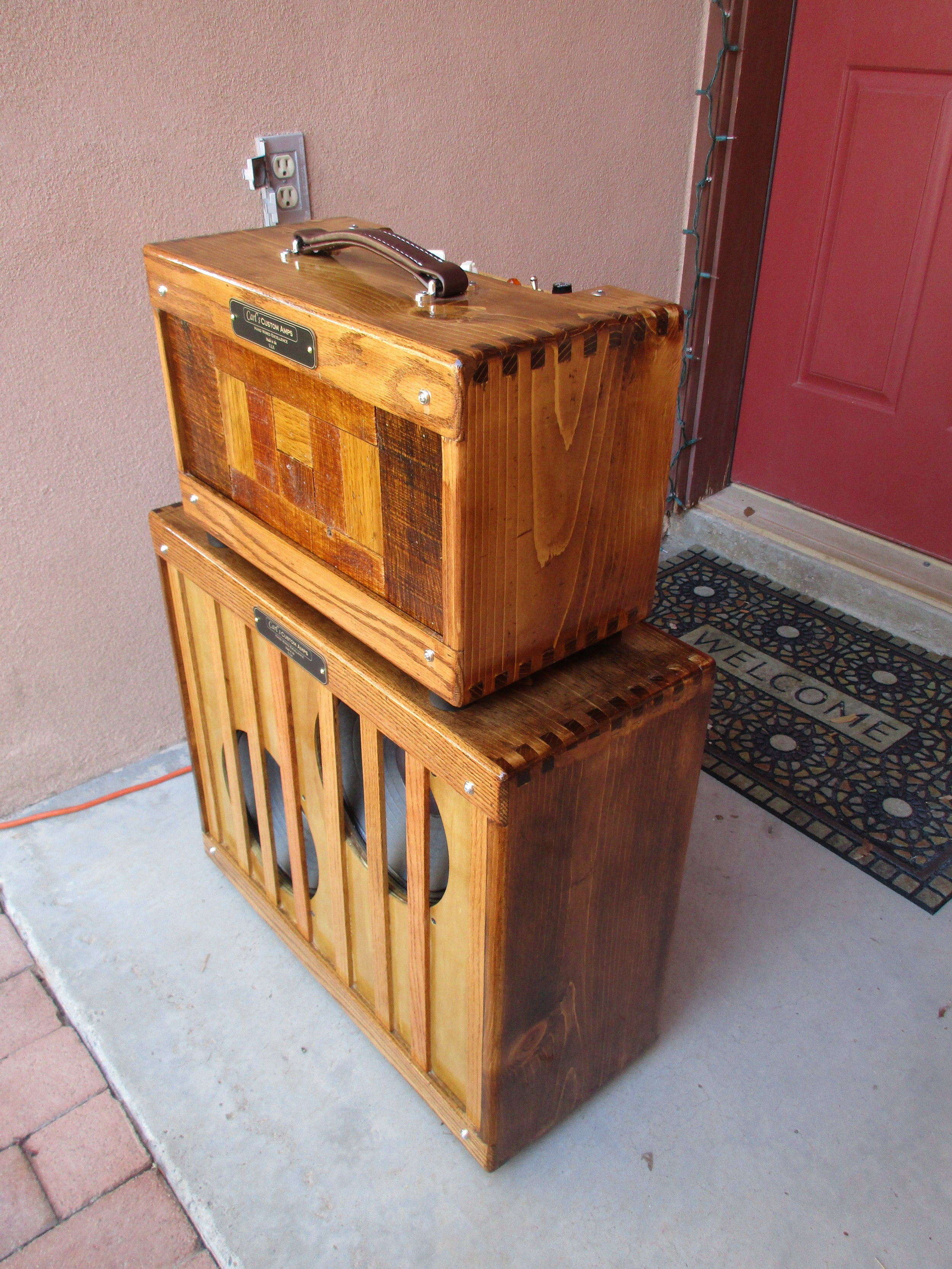 This one was really fun to build. I did for long time customer and friend. It's my Octal Princeton but with fancy hand finished cab made of pine and oak. The front pieces on the head are salvaged from pallets. The 2x10 cab is loaded with Weber DT10s. In keeping with the look I made the baffle with oak strips as cone protector rather than grill cloth. The finish was 15 coats of a wipe on varnish I mixed up. Lots of work but I'm pleased with the result!