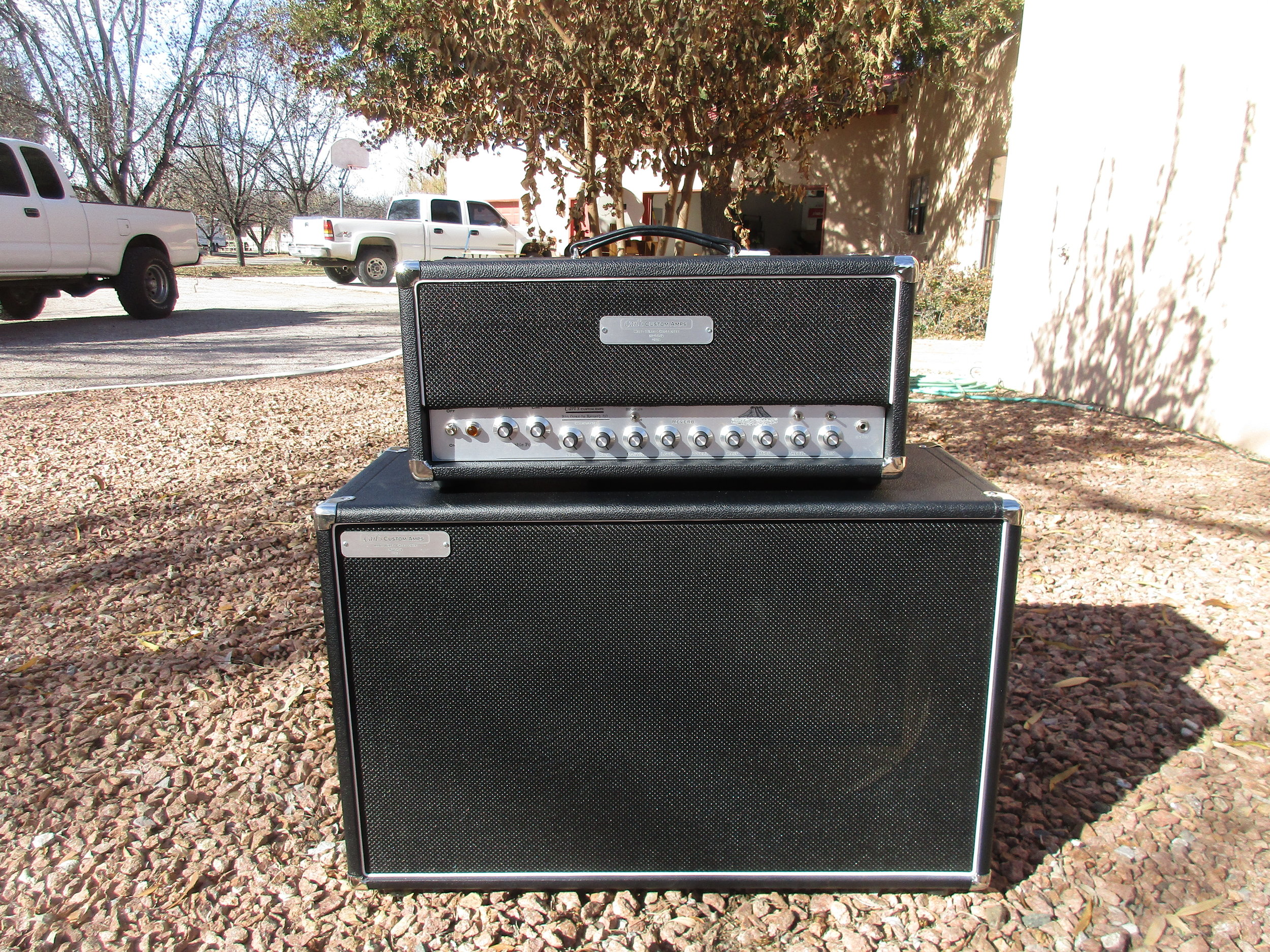 This one cool custom build! It's Dumble/ Two Rock inspired amp made to do big smooth cleans and be a pedal platform. However it's far more than clone. It got Variable Power so that it can go from a full 50W to 1/10W for cranked tone at any volume. It can use most Octal power tubes for additional tonal textures. It has SAG control that allow you to dial in the feel of the amp and a bunch of voicing switches (like most Dumbles) but includes one of my own devising to allow to get more sparkling Fender sound than can be had stock. There are lots of sounds in there! The cabinet is a detuned cab with single Weber Michigan 12 which is similar to the EVs Dumble often shipped his amps with.  The customer wrote:  Carl I just want to say this is the most incredible amp I have ever had the privilege of playing . Thanks for taking your time with me and hammering out all the details . You went above and beyond . I never imagined a Amp could sound this good —-ERIC
