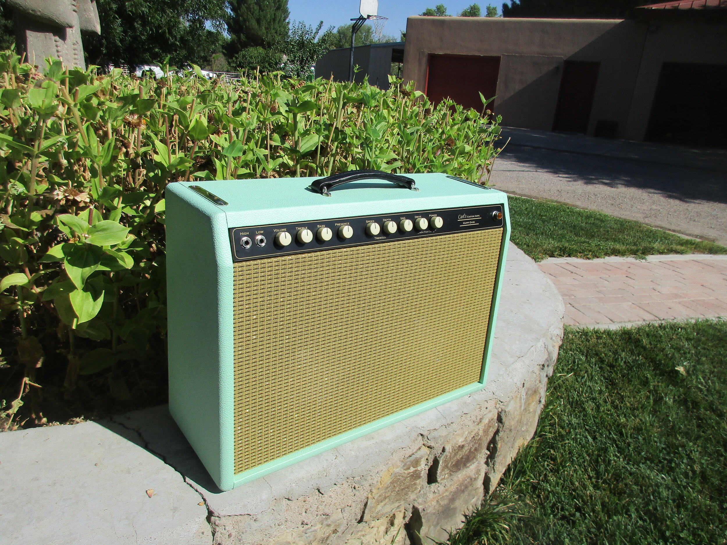 This custom amp is one of my Blonde 20s  but with a twist. It's a 2x10 version with Weber speakers and has on board London Power Scaling and a SAG control. It's got this great stinging sort of overdrive and glittering cleans.  s