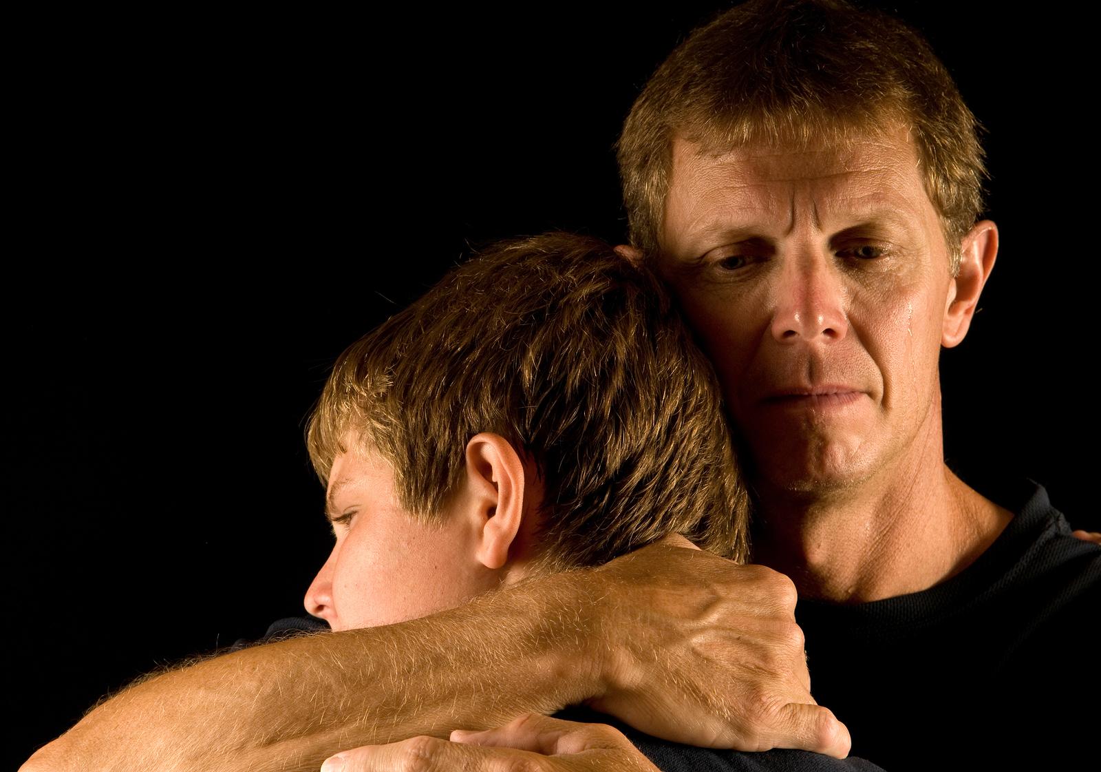 bigstock-Father-hugs-son-5655891.jpg