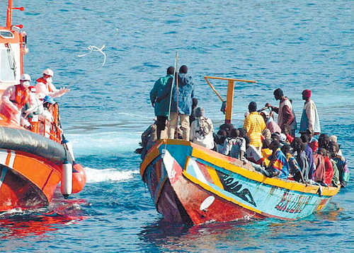 """""""Rescue operation (off the canaries)"""" by Noborder Network. Licensed under CC BY 2.0 via  Wikimedia Commons"""