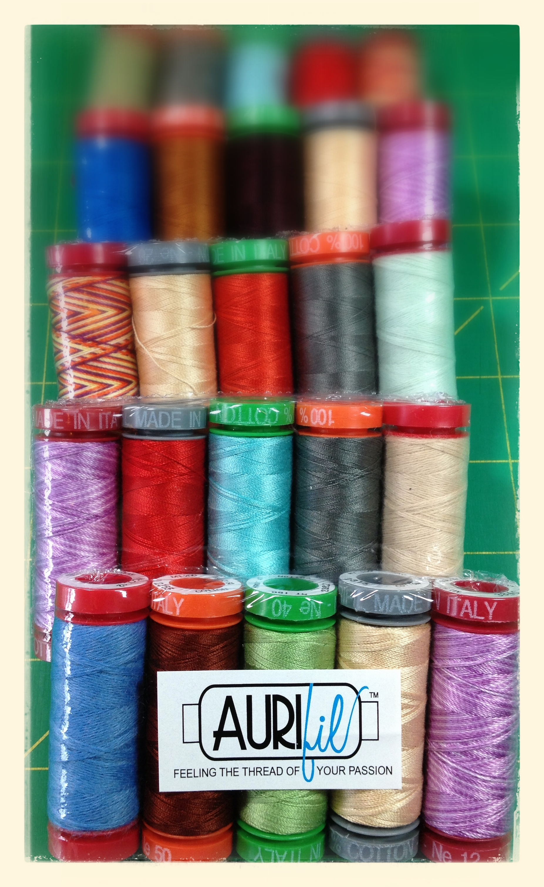 Aurifil sampler packs: 5 spools of thread in each, varying types and colors.