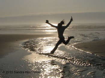 """Joy""--of girls playing on the beach in Oregon when we finally let them out of meetings."