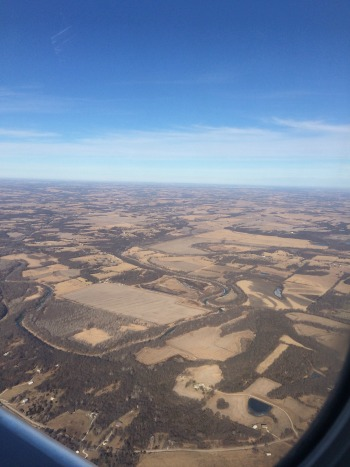 From my plane window, somewhere over Missouri, heading home. It was nearly 60 there--arrived home to under 30 degrees and snow.