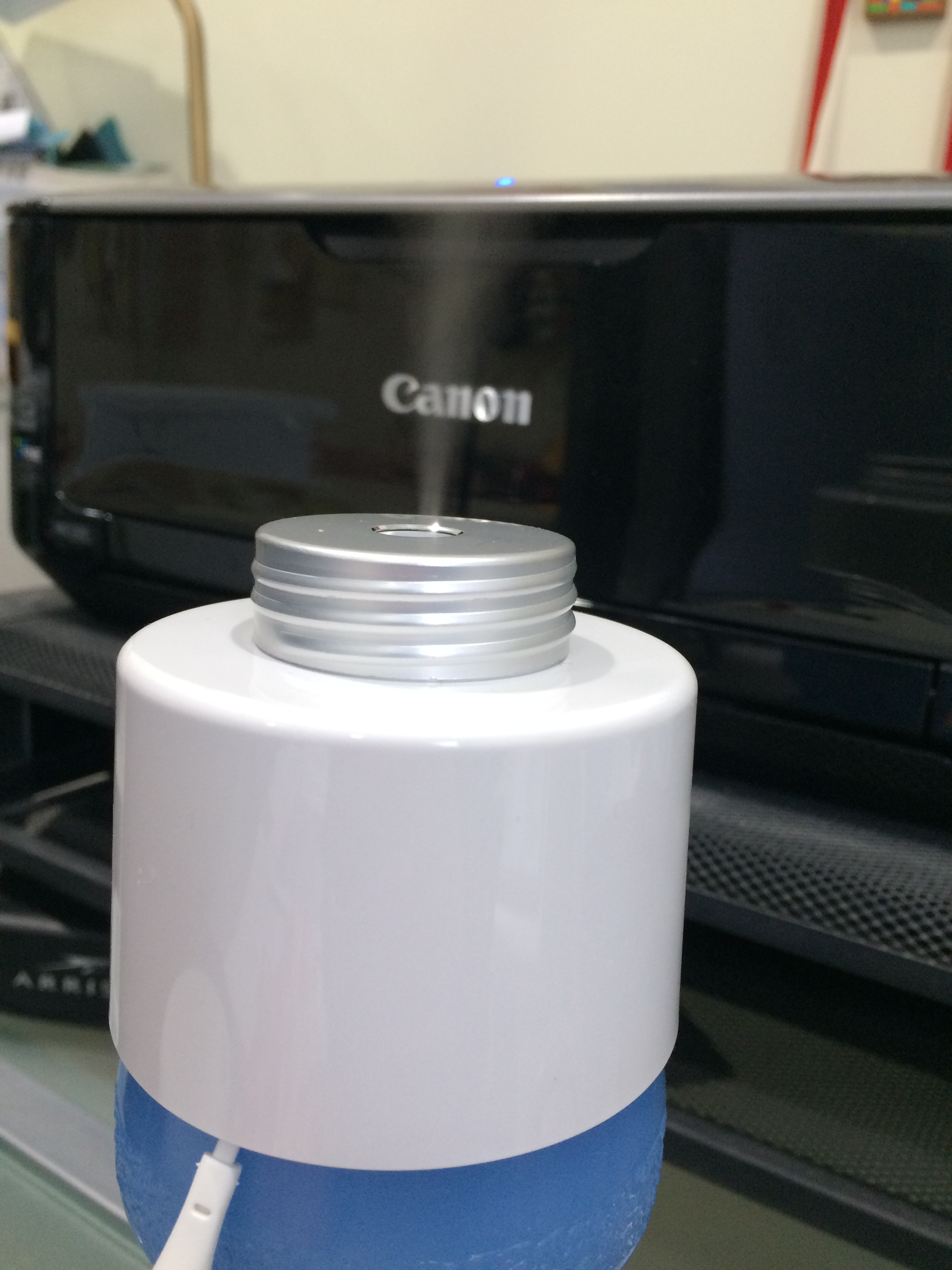 The portable humidifier attached to the top of my water bottle, steaming away.