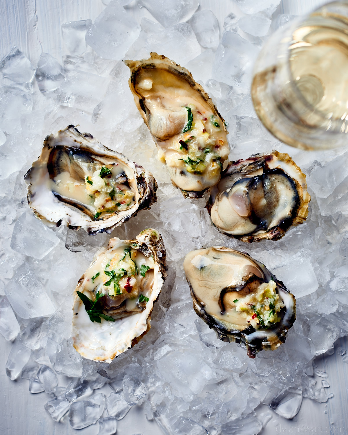 Fresh oysters with Champagne vinegar, lemon, mint and horseradish.