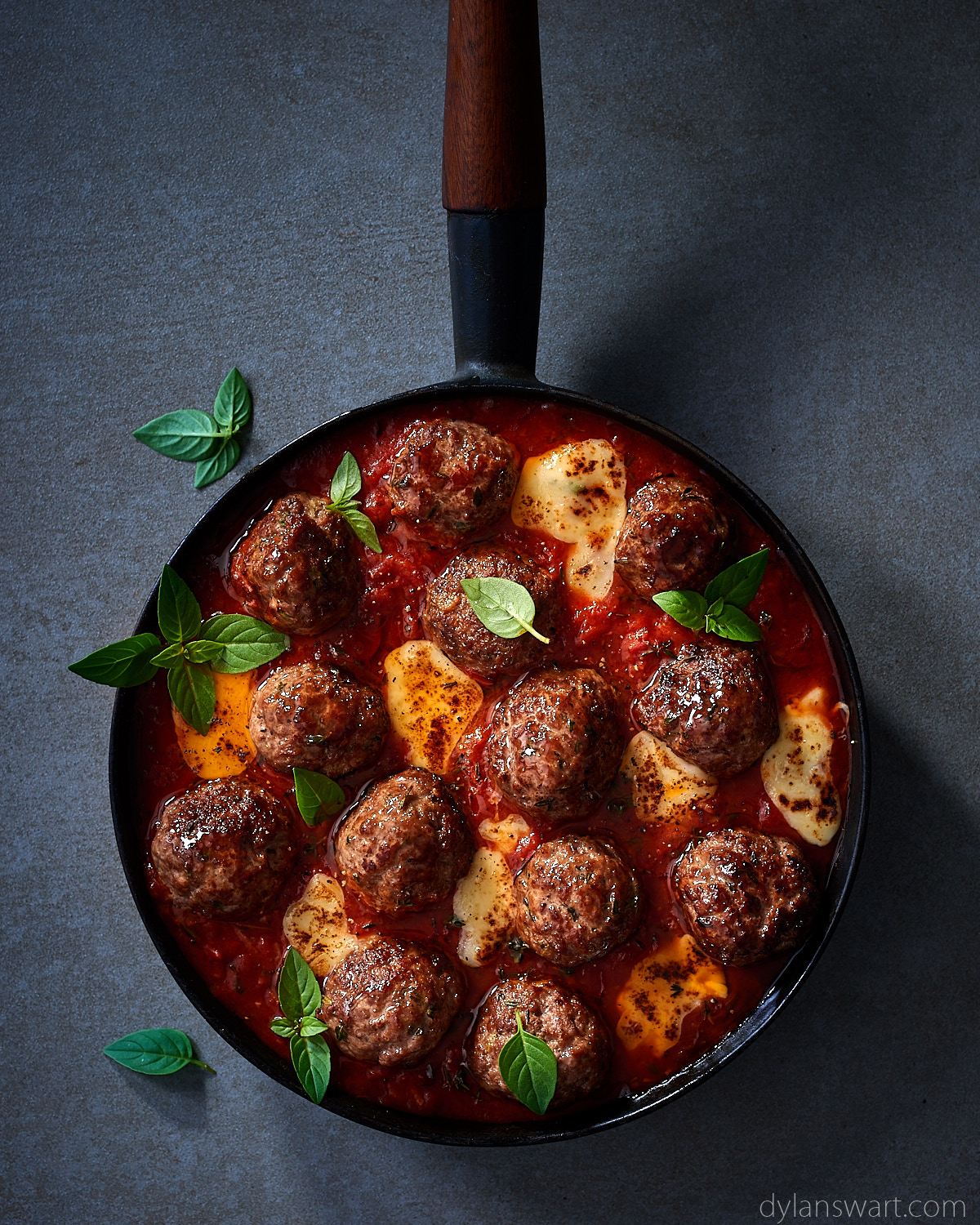 Herbed meatballs in tomato sauce with melty mozzarella