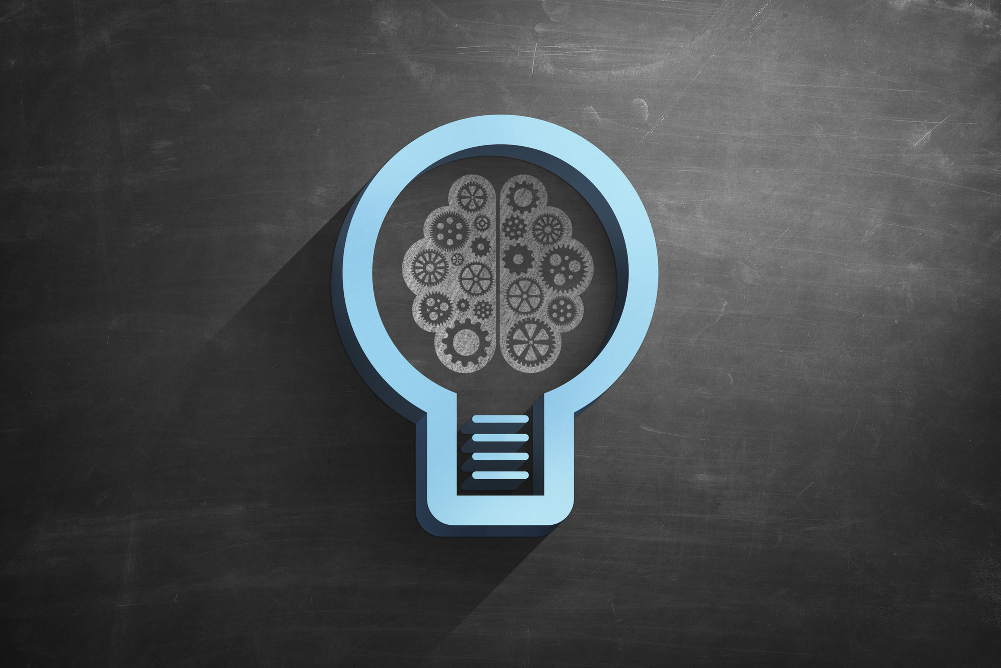 Illustrated light bulb and Brain on Blackboard.jpg