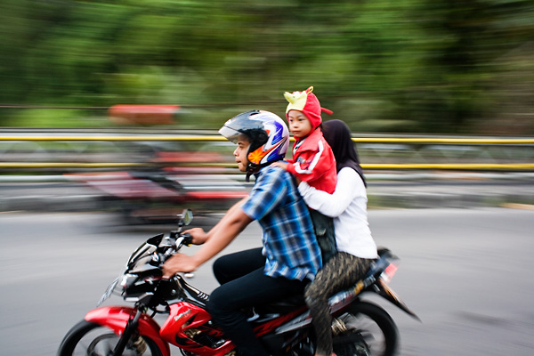 Bali Documentary Photograph, Balinese family with baby riding a motorbike in Ubud