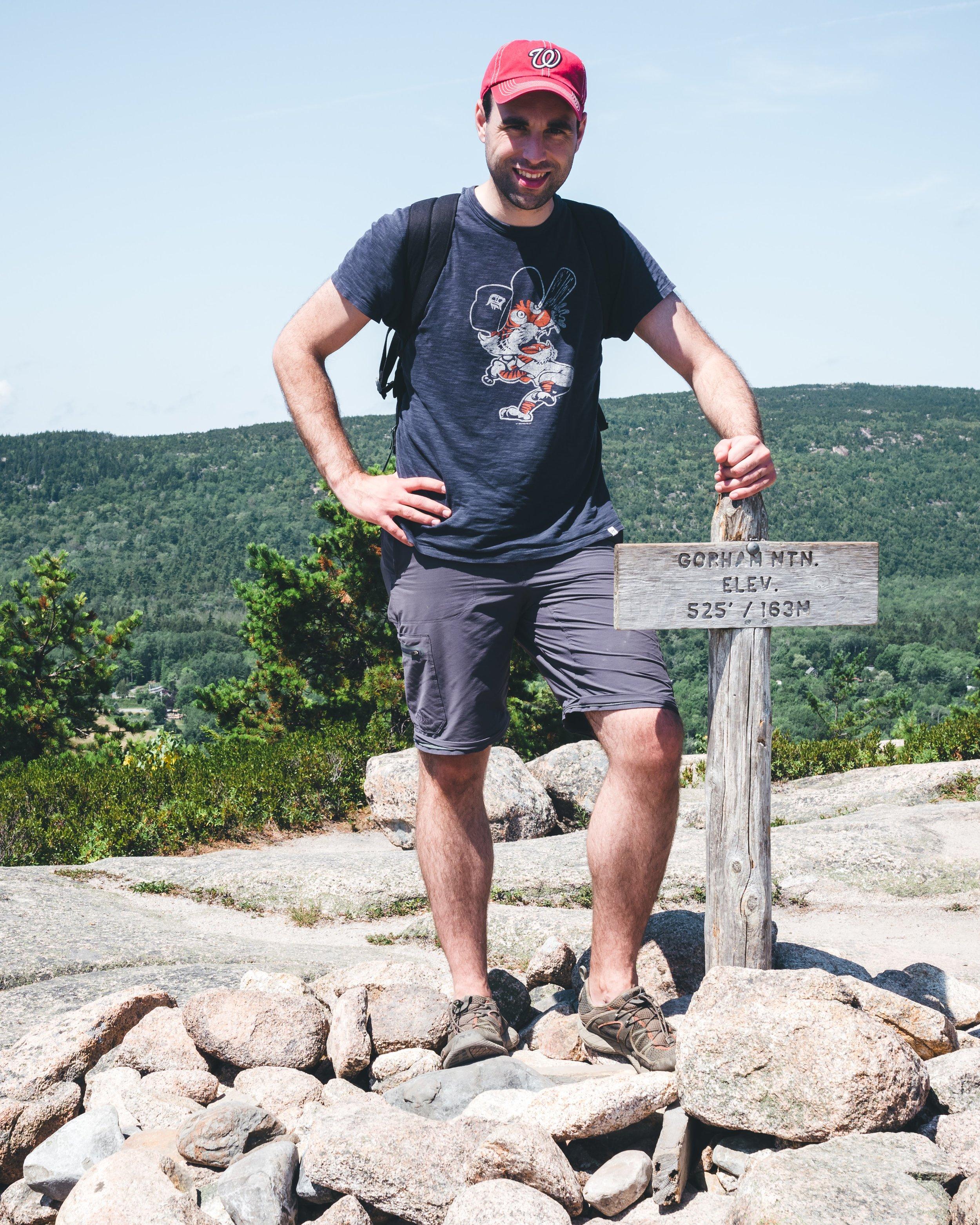 Brandon next to the Gotham Mountain summit.