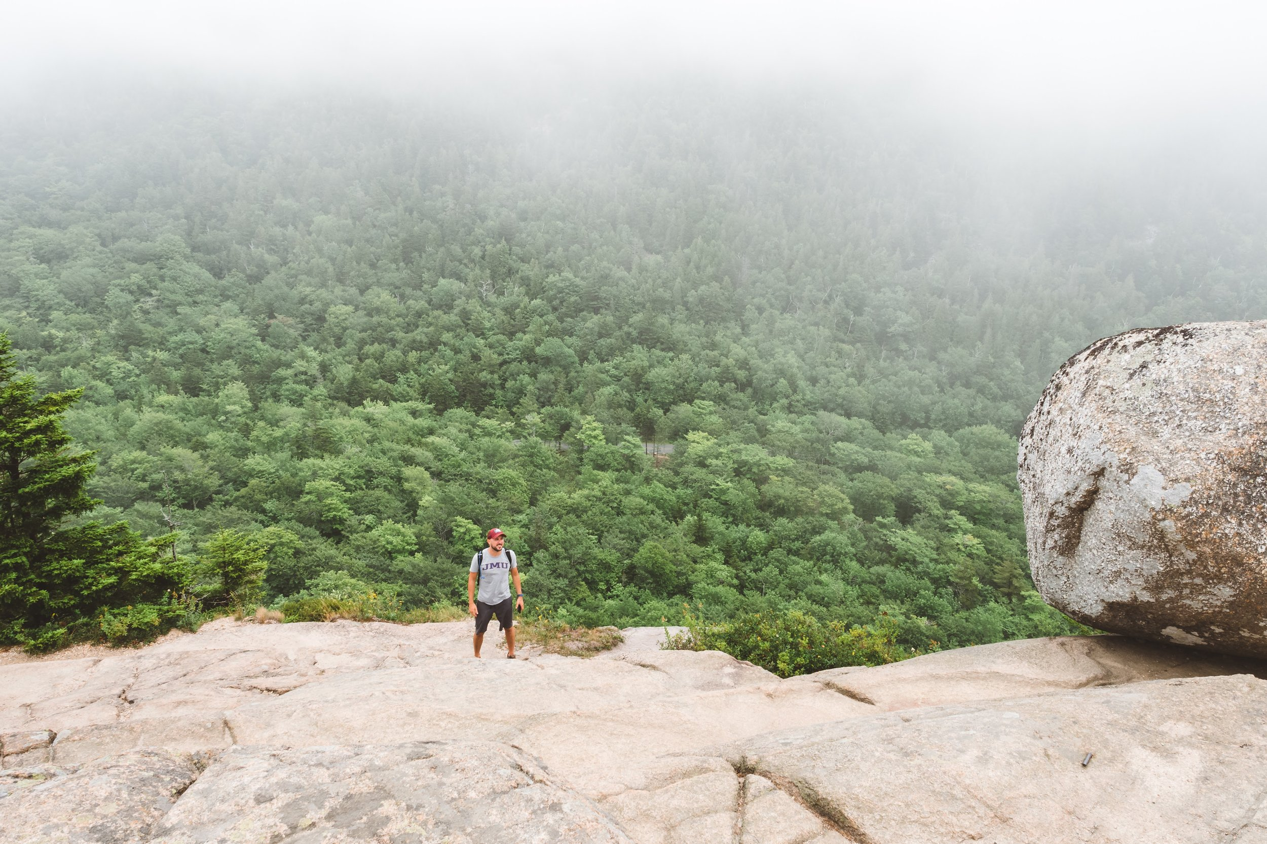 Luis stands near Bubble Rock.