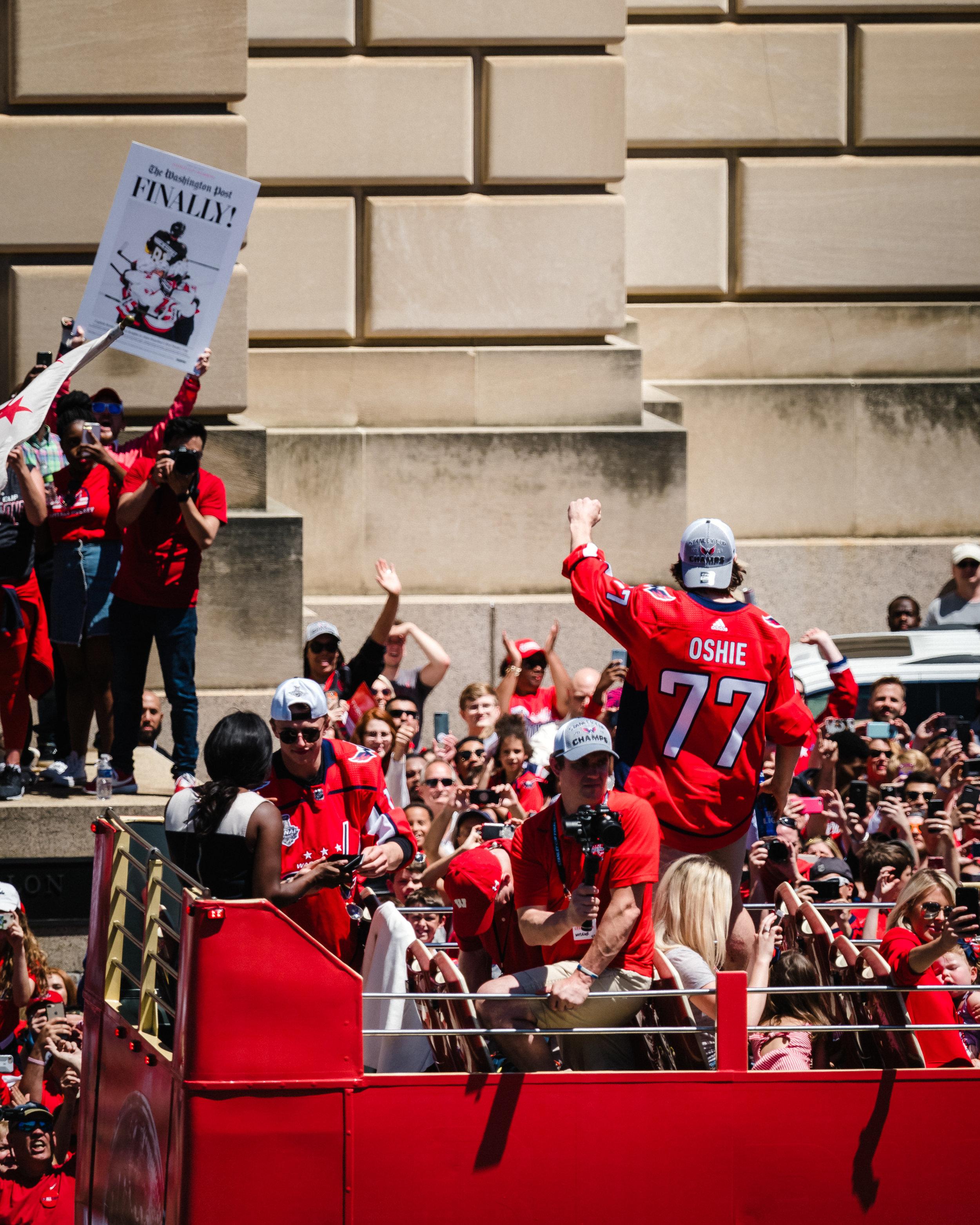 TJ Oshie salutes the fans.
