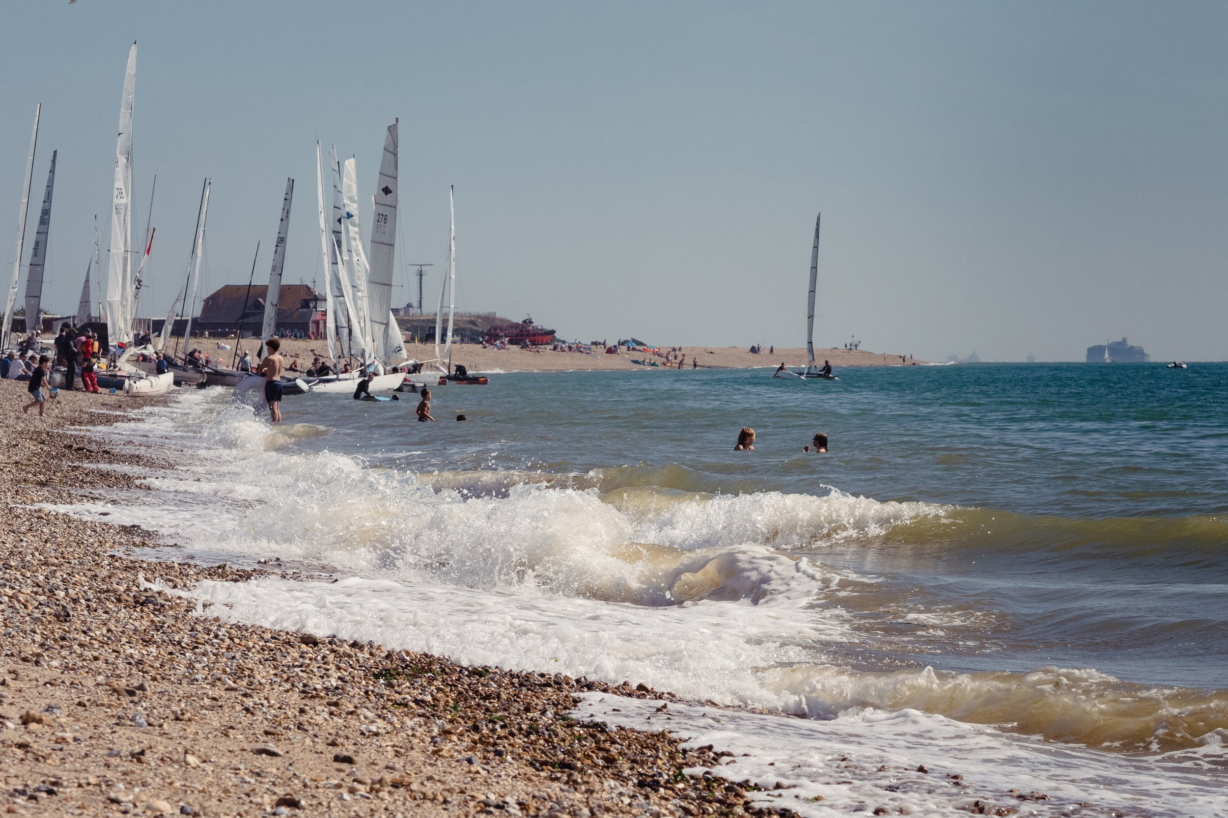 Families and sailors alike enjoy a late summer afternoon on Stokes Bay.
