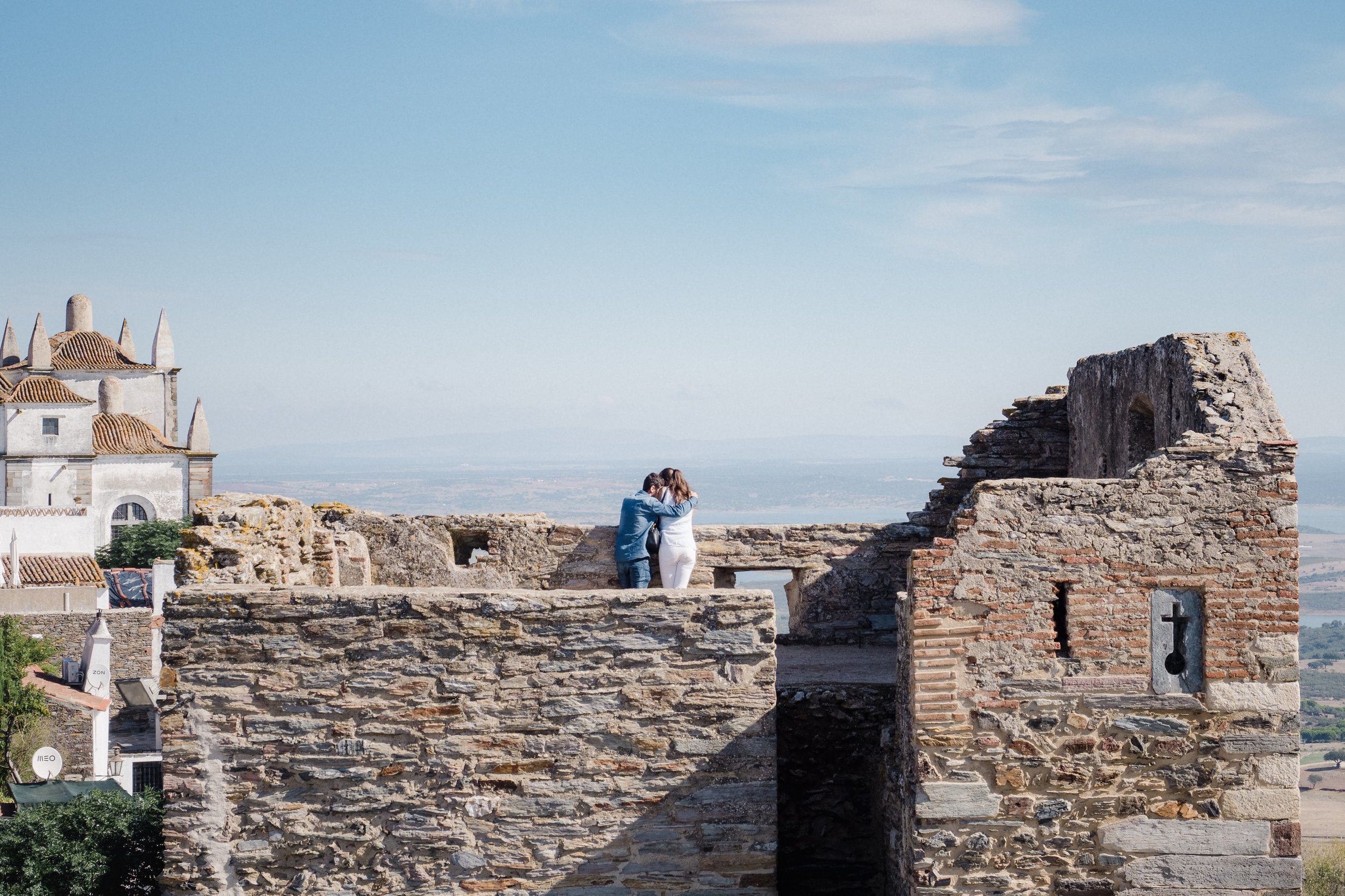 A young couple takes in the view from atop the castle in Monsaraz.