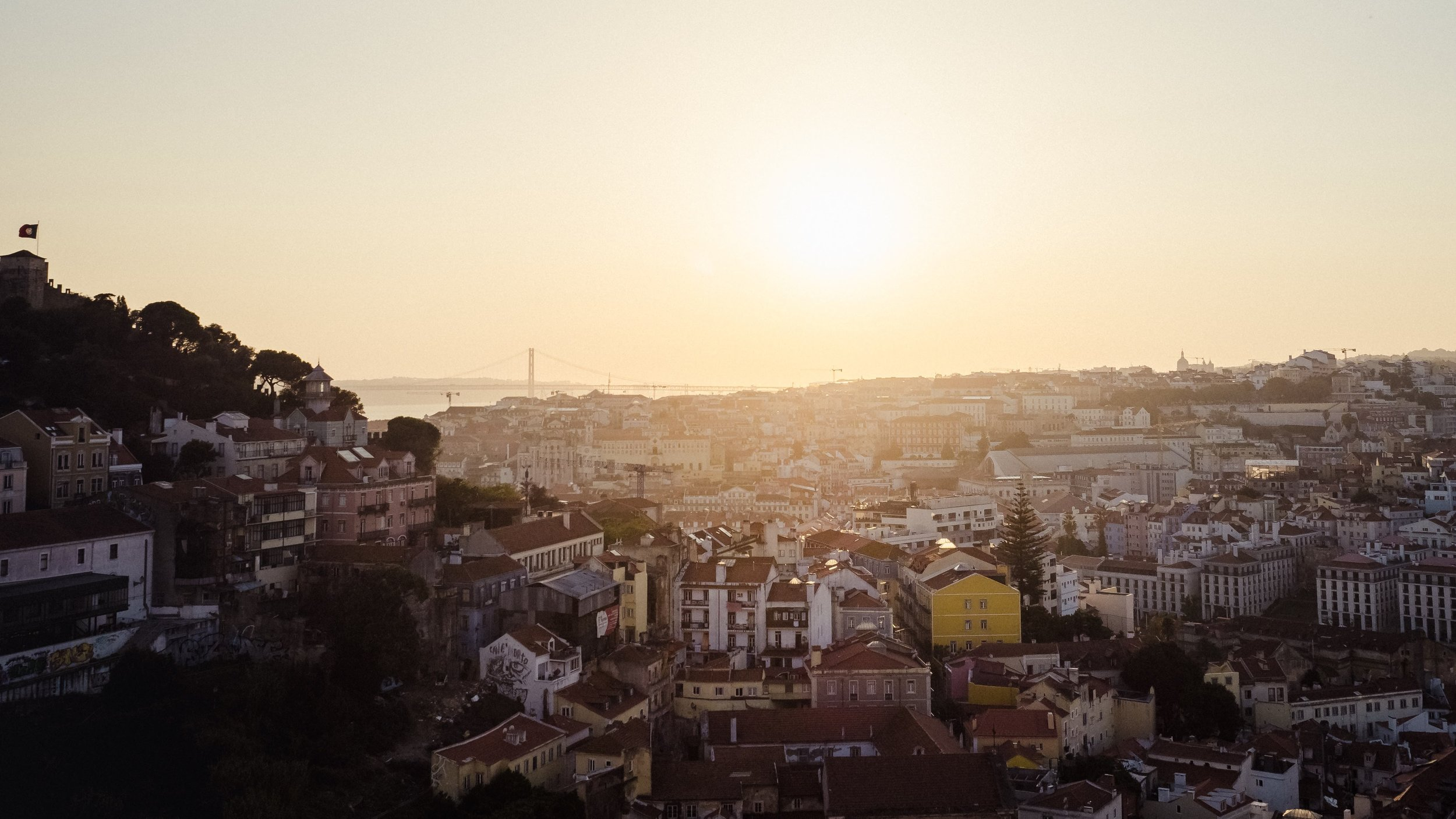 A Lisbon sunset, as seen from Miradoura da Graça.