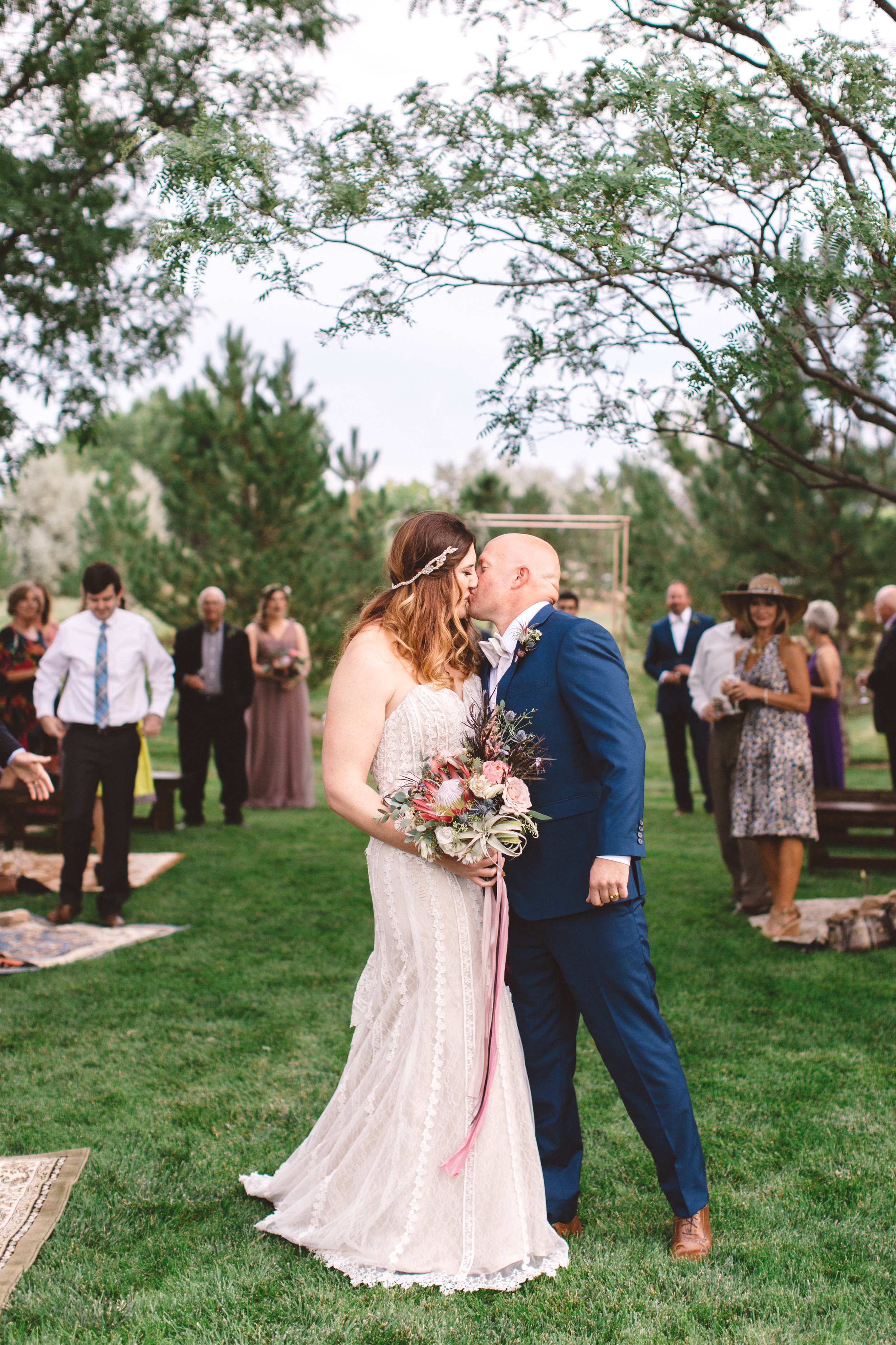 Always my favorite shot - Take my advice... remember to stop at the end of the aisle and kiss again.Because you get this.
