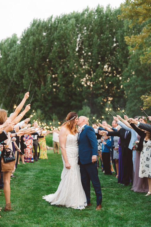 Here's a tip - If you don't have enough time in your photography contract hours to do a grand exit (with sparklers, for example), do a grand entrance into your reception instead!