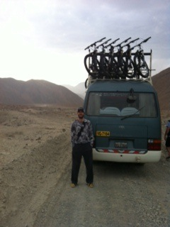 Troy  posing behind our transport van.  We drove some of the most insane mountain roads in this bad boy.  Tight sphincters to say the least…