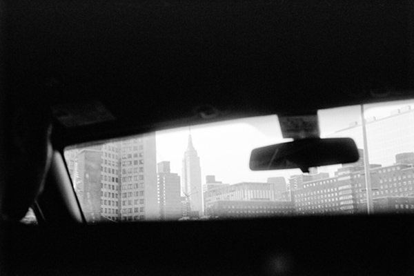 View of Empire State Building through Taxi Window