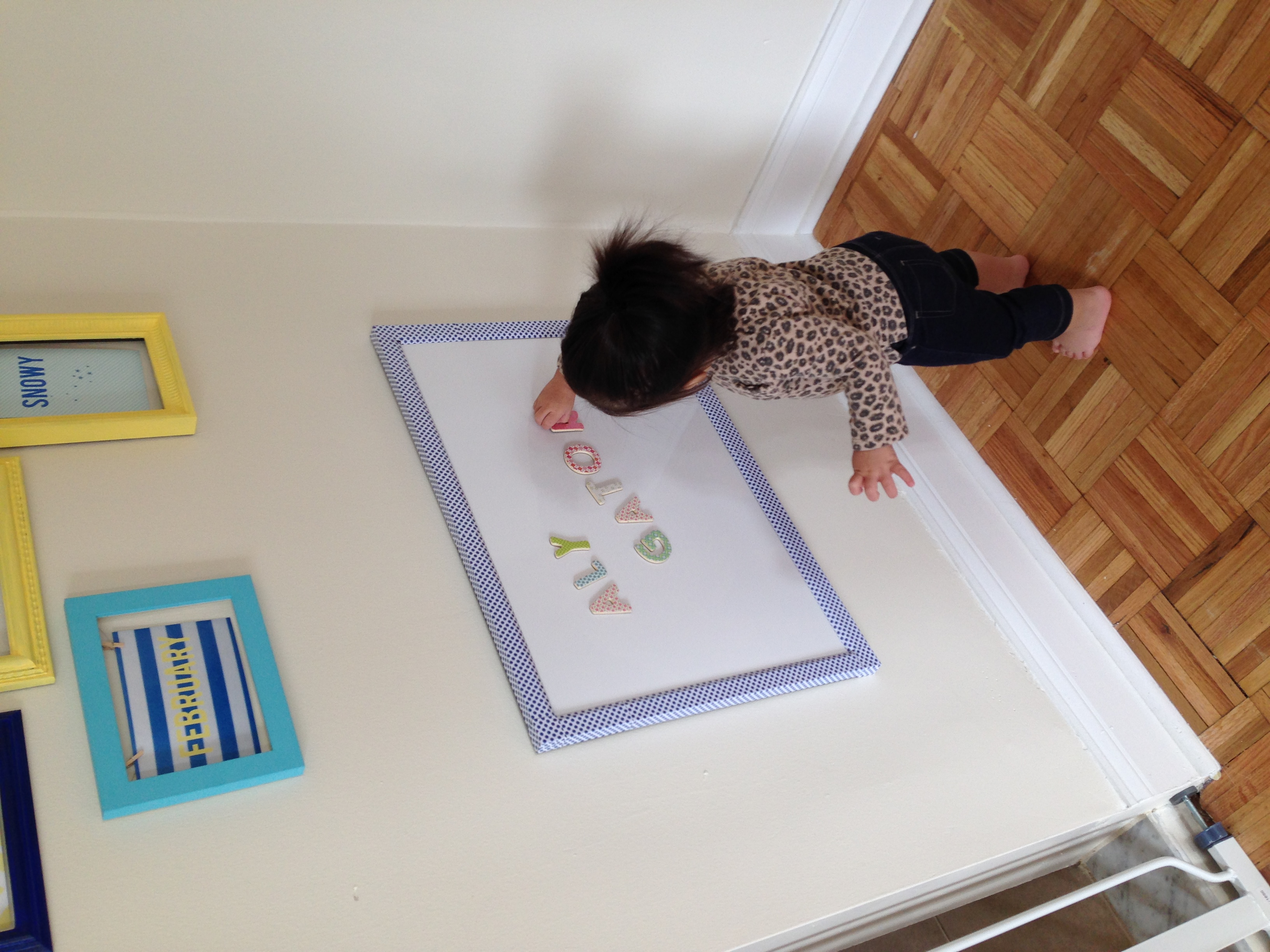 This dry erase/magnet board has been a huge hit! I showed Alynne how to use magnets once and she was hooked! She plays with them every day!
