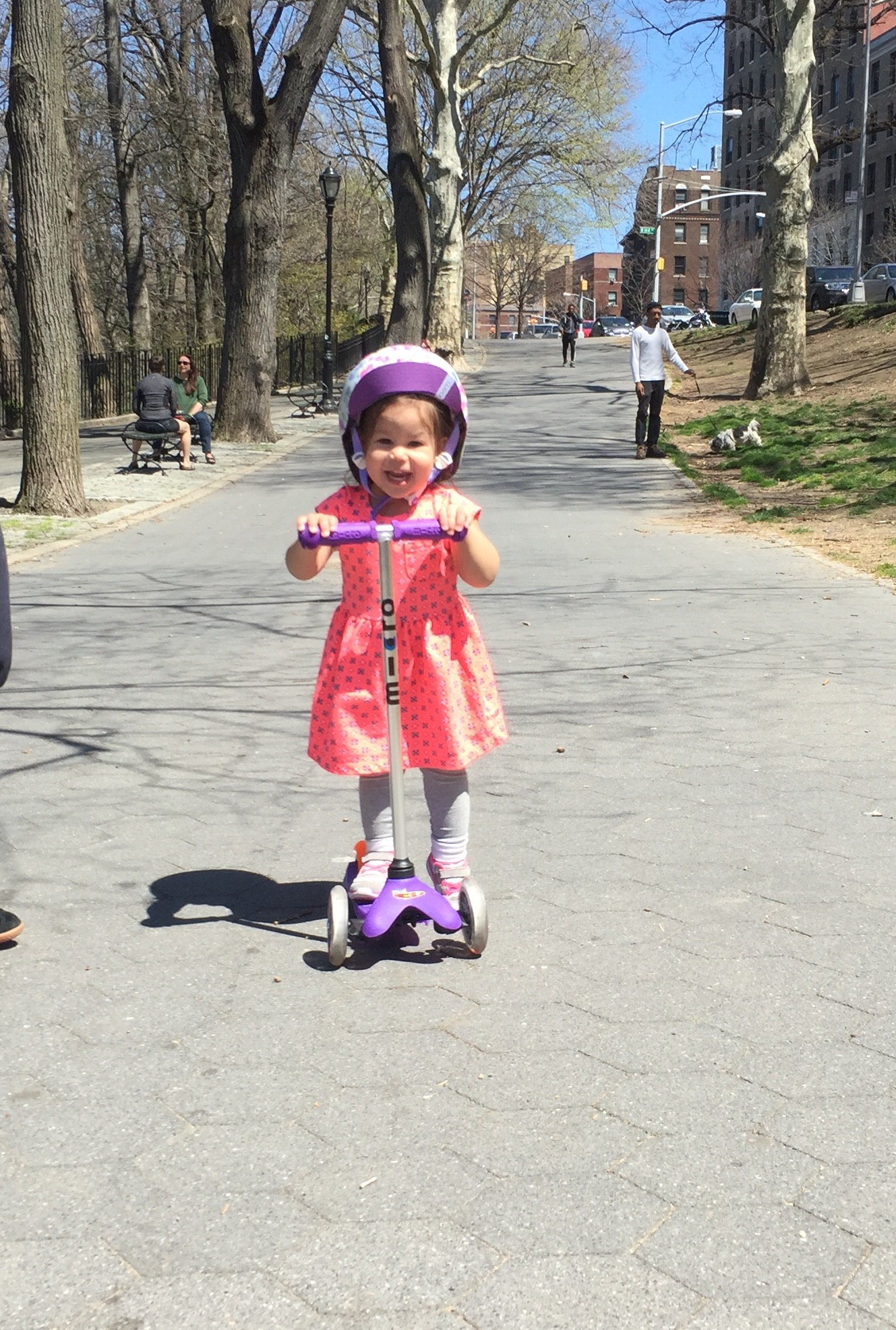 Practicing riding her scooter