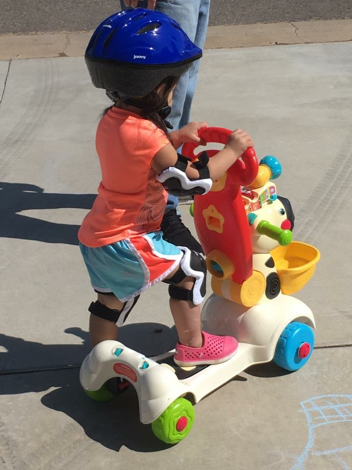 riding a scooter!