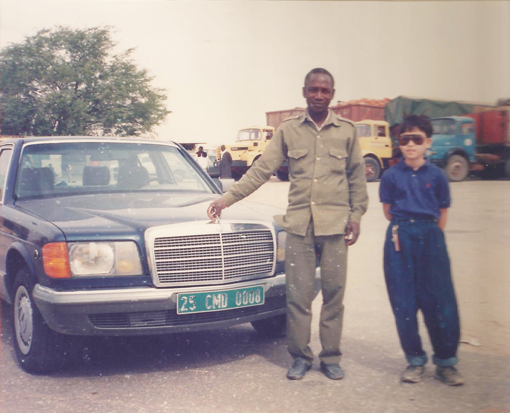 Mauritania, in northwest Africa.  I am on the right.  During the plague every inch of that car would be covered in locusts basking in the heat.  Also, I bring 'hammer pants' to Africa.