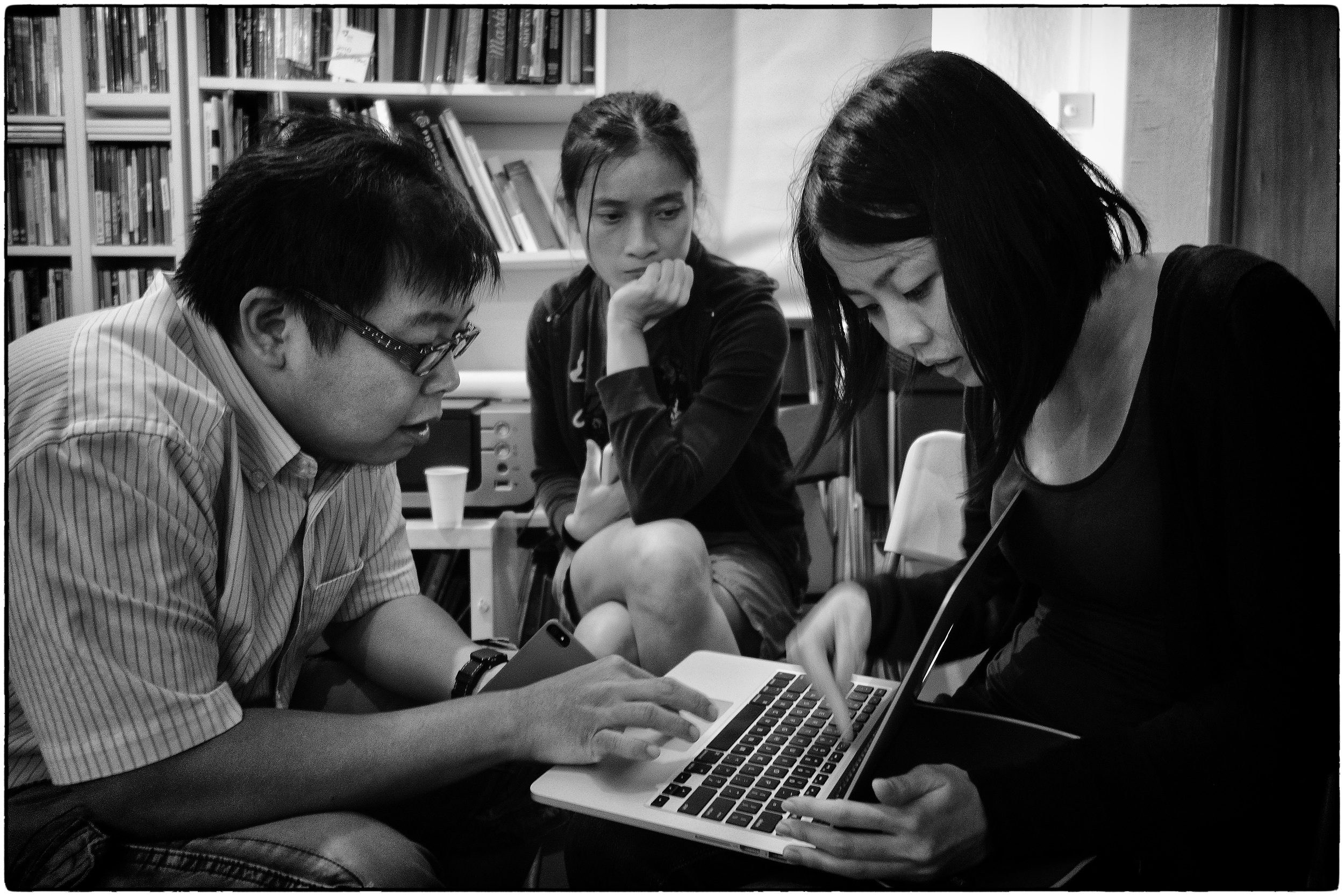 Cheryl (on the right) gets an edit from Darren and Wei Leng.