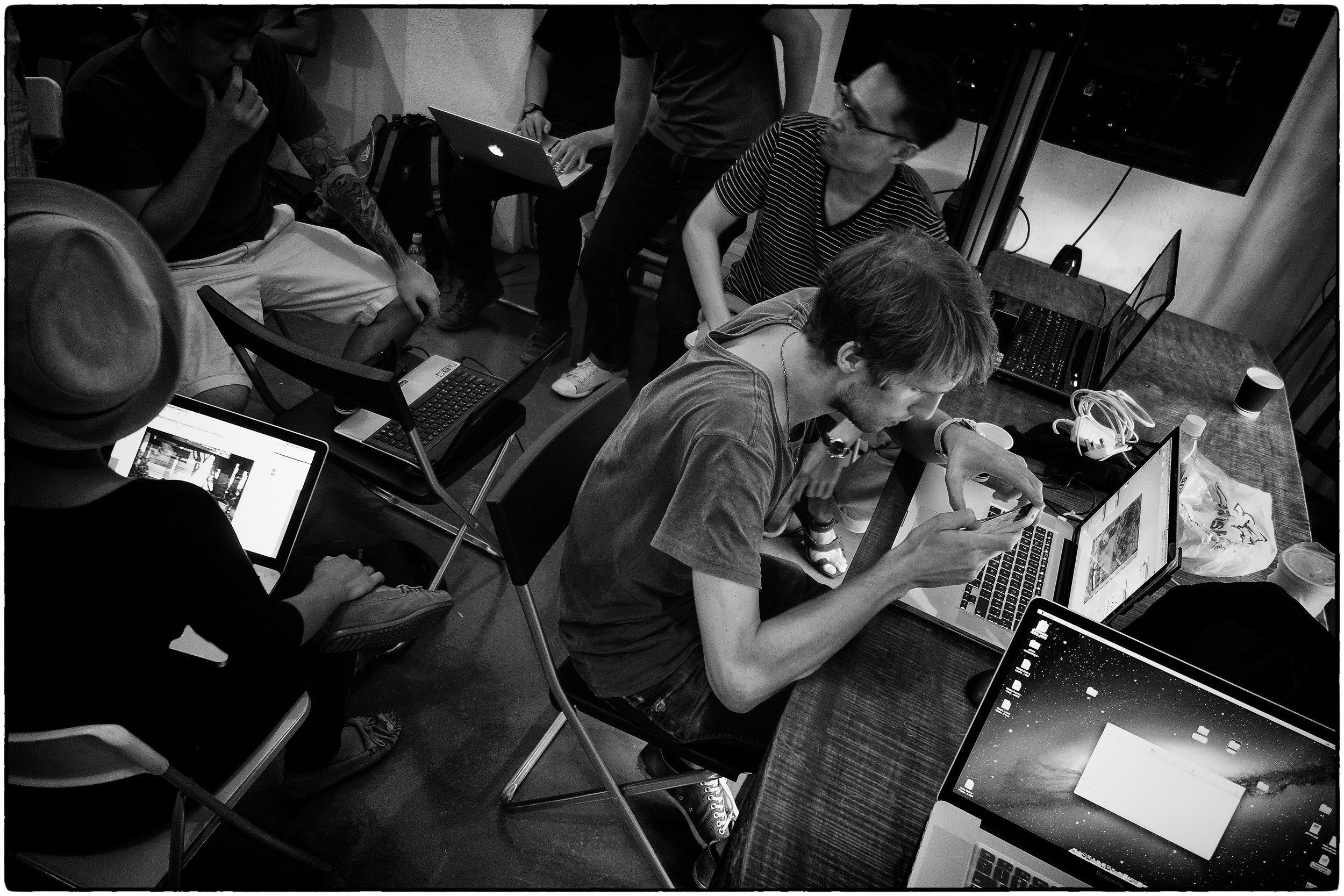 The computers all come out as participants prepare their images for printing and final sequencing of slideshow photos are tweaked.