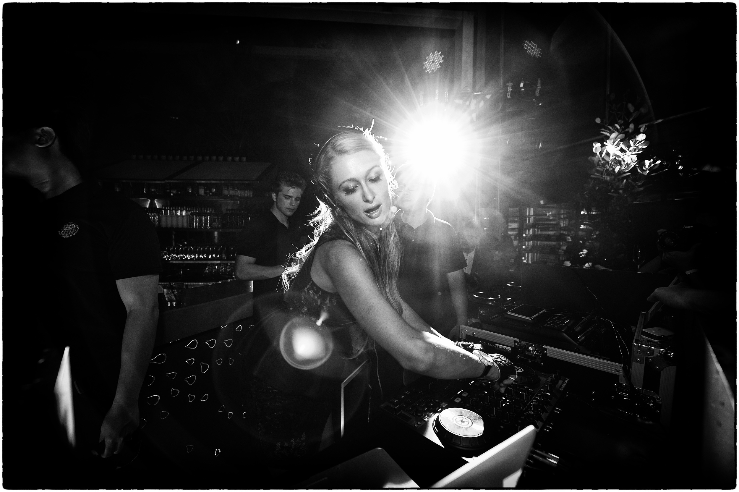 Paris Hilton spinning at ME@OUE af a Singapore GP after-party.