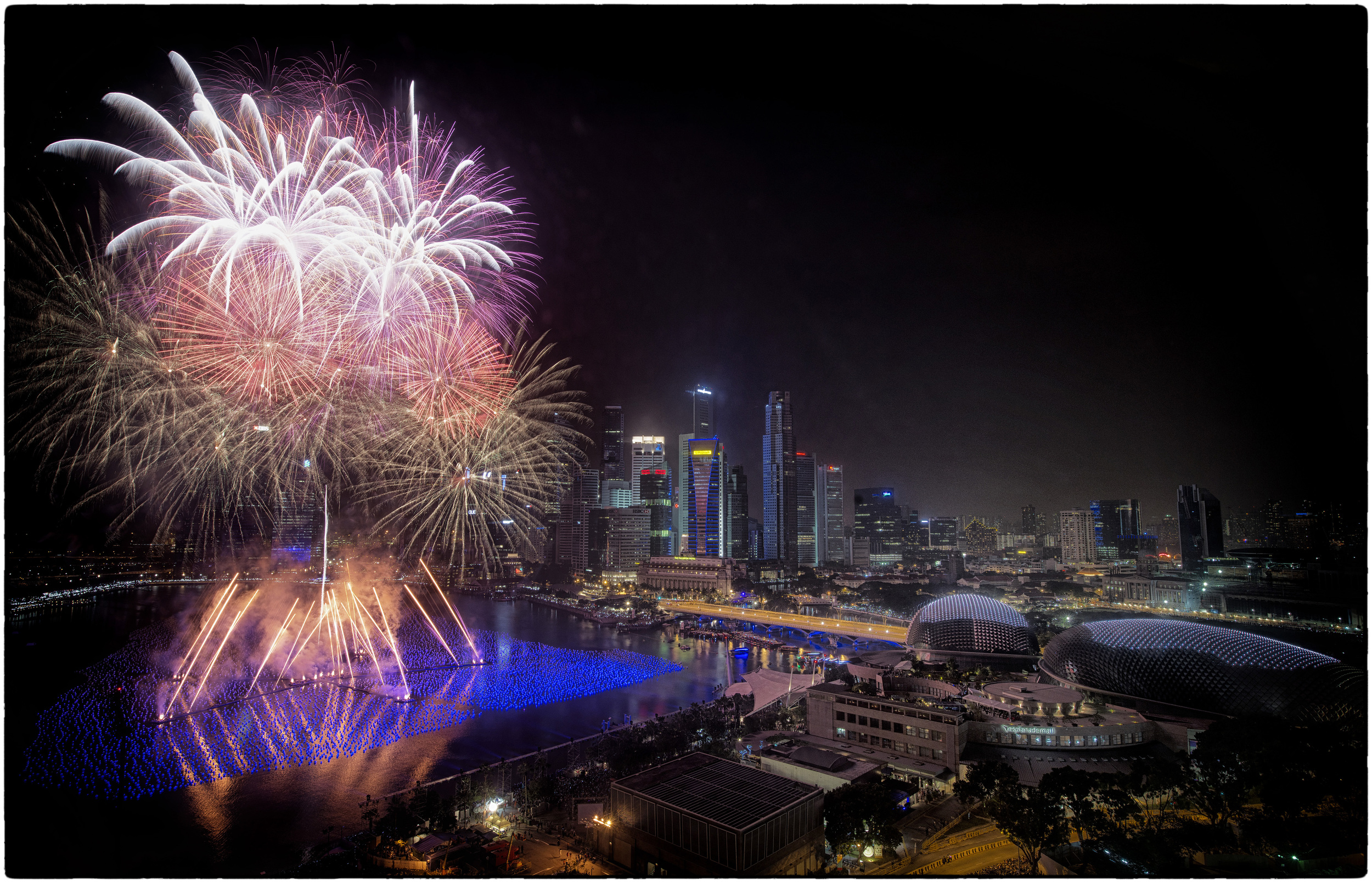 Fireworks light up the Singapore skyline as the country ushers in 2014