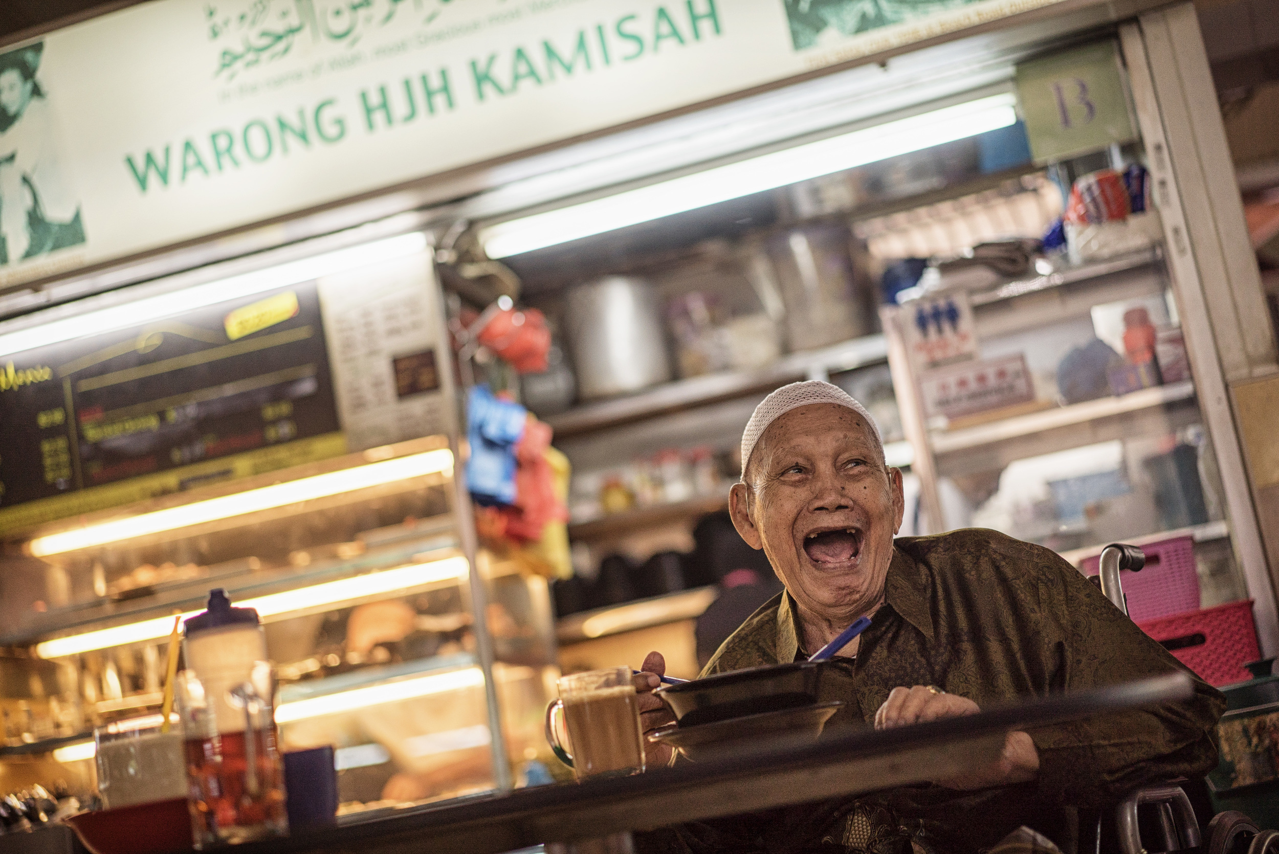 Ngalirdjo Mungin started hawking satay on the streets. Like thousands of other hawkers, he moved to a stall in a food centre in the early 1970s which is now operated by one of his sons.