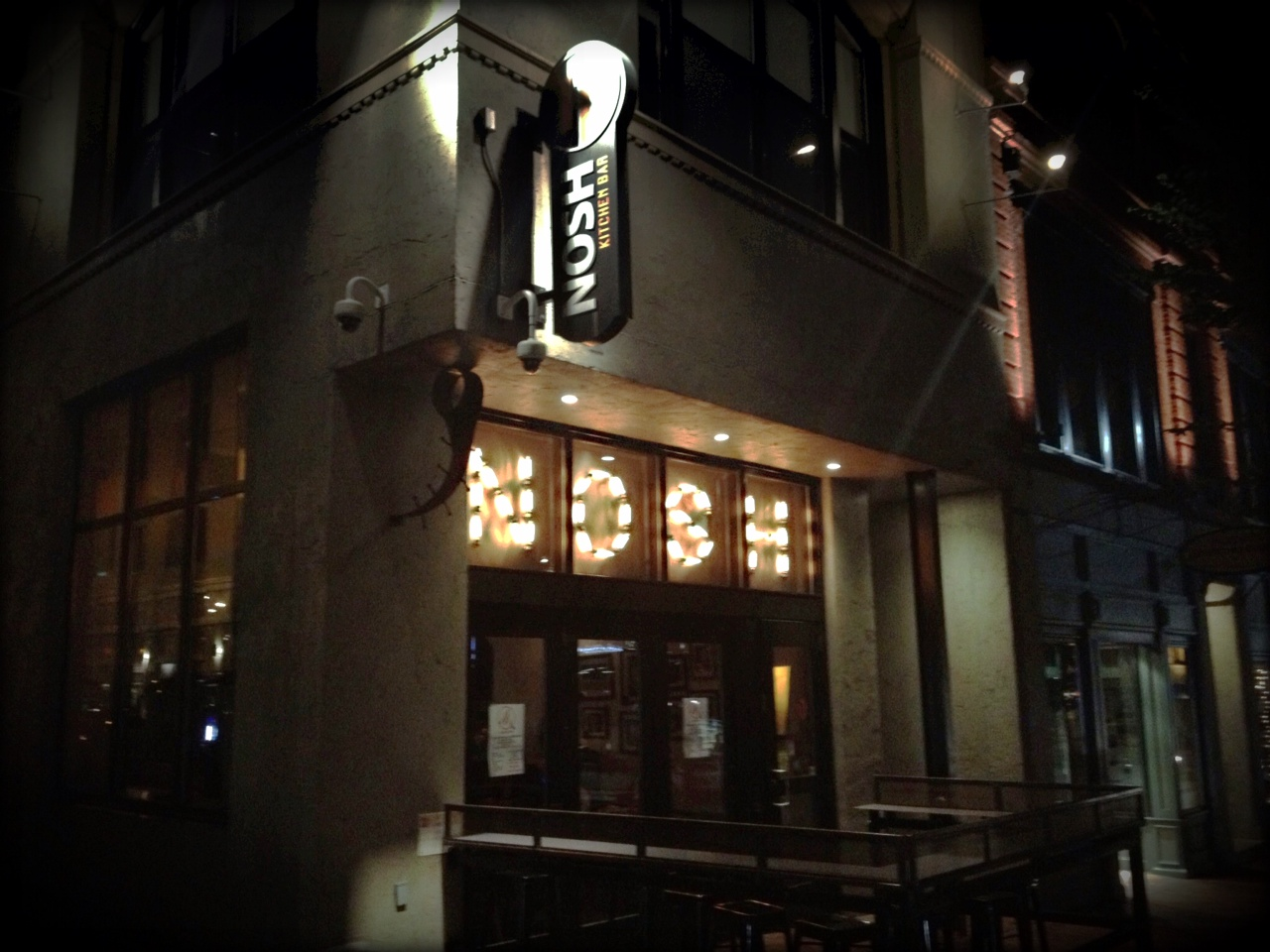 Nosh sign in its night time glory.