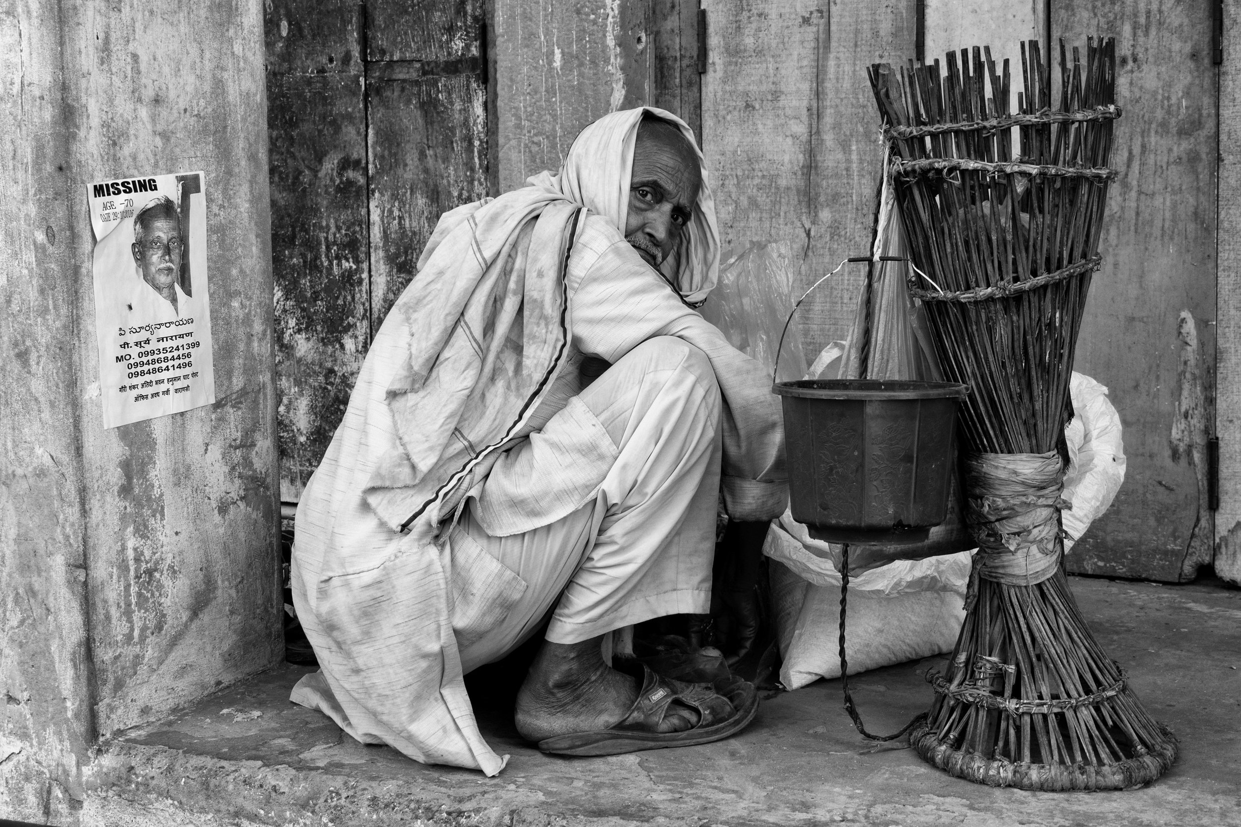 Man Crouched Down on Streets on Varanasi in Black and White - Varanasi, India - Copyright 2016 Ralph Velasco.jpg