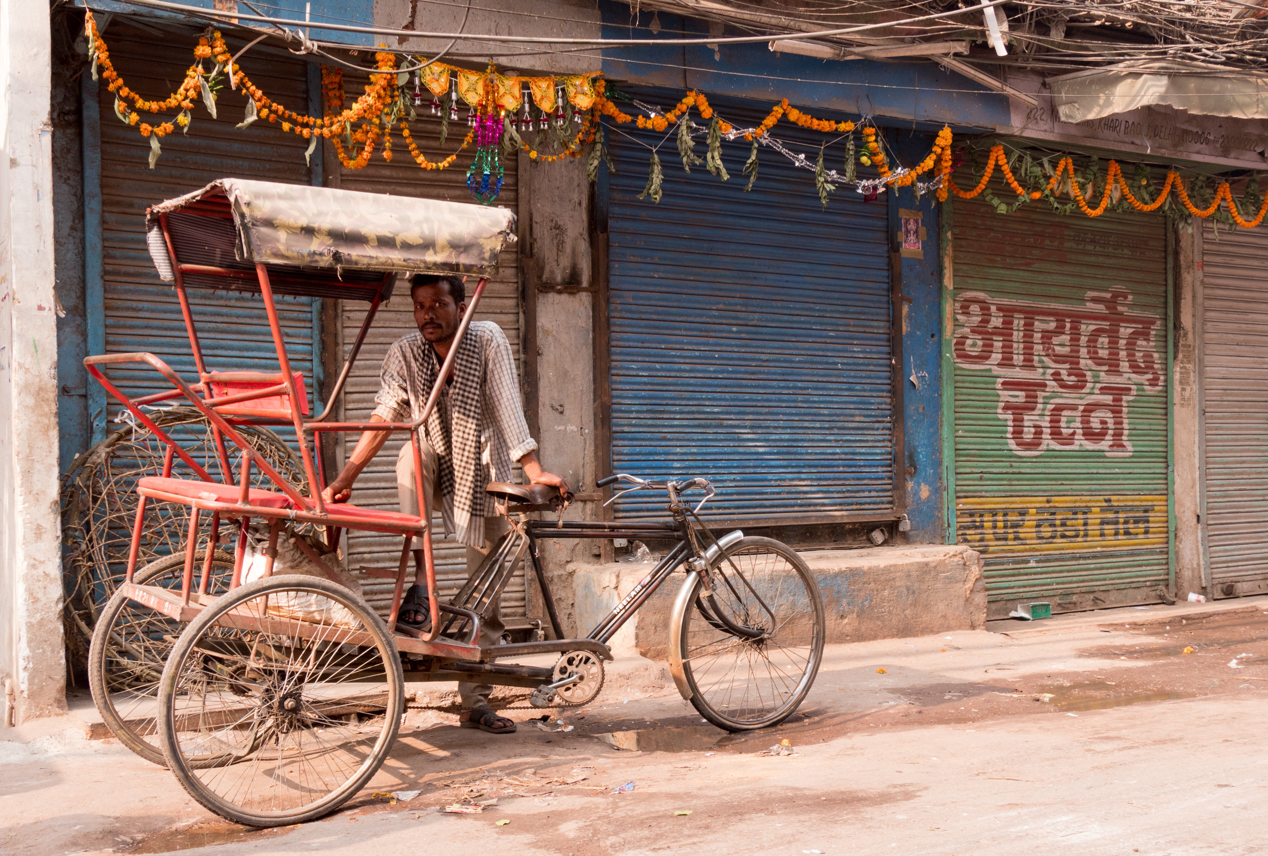 Man Standing with His Rickshaw at Spice Market - Old Delhi, India - Copyright 2016 Ralph Velasco.jpg