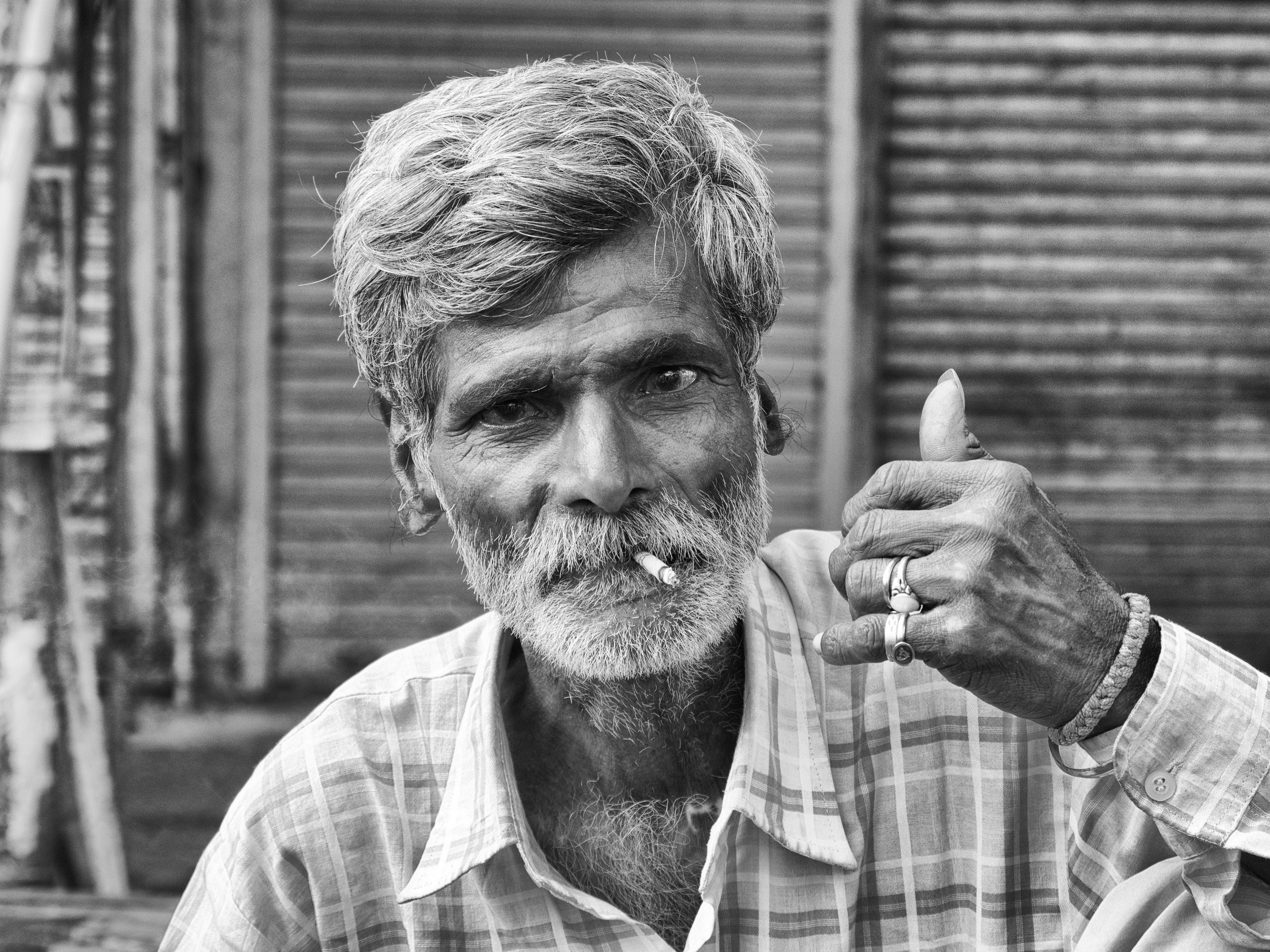 Man with Cigarette at Spice Market in Black and White - Old Delhi, India - Copyright 2016 Ralph Velasco.jpg
