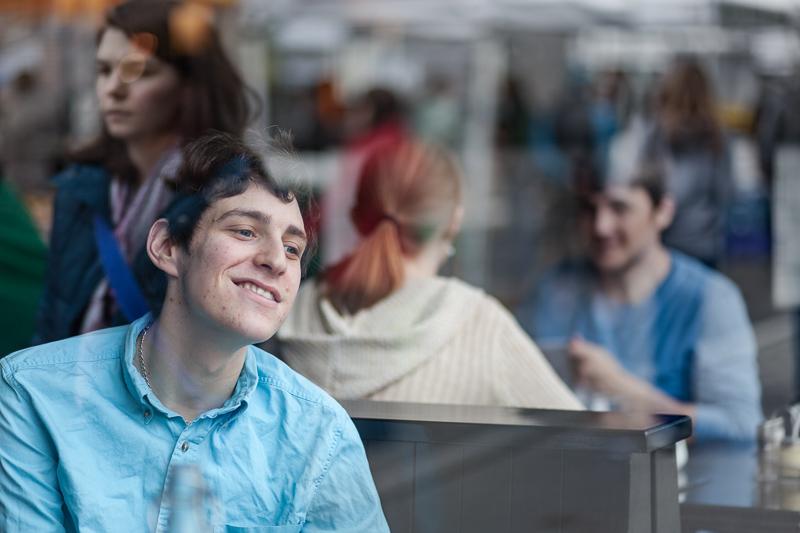 D.Julian-Smiling Boy in restaurant window.jpg