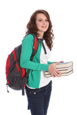 teenage girl holding books