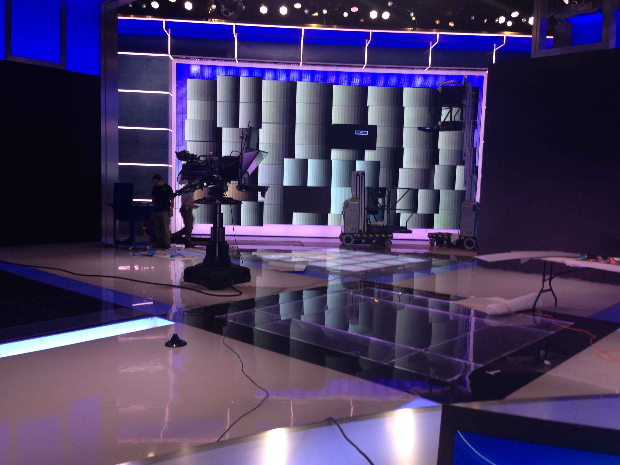 A look at calibrating 56 LCD and plasma monitors using Medialon to make sure the image is uniform and color-matched when seen through a broadcast camera.